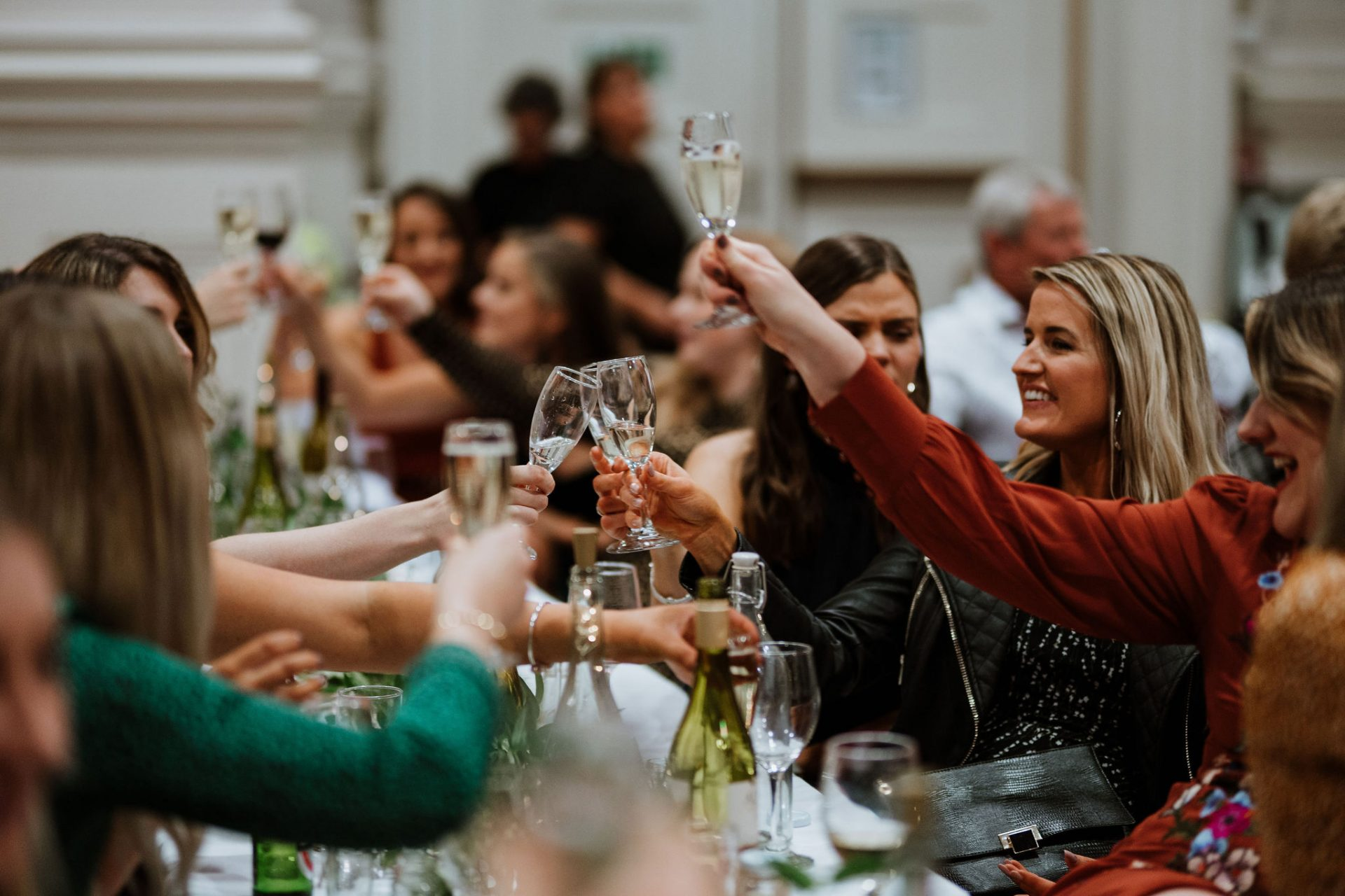 guests cheer toast champagne