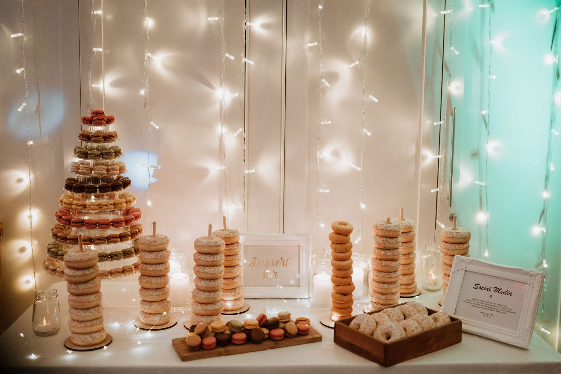dessert table donuts macaroons fairy lights