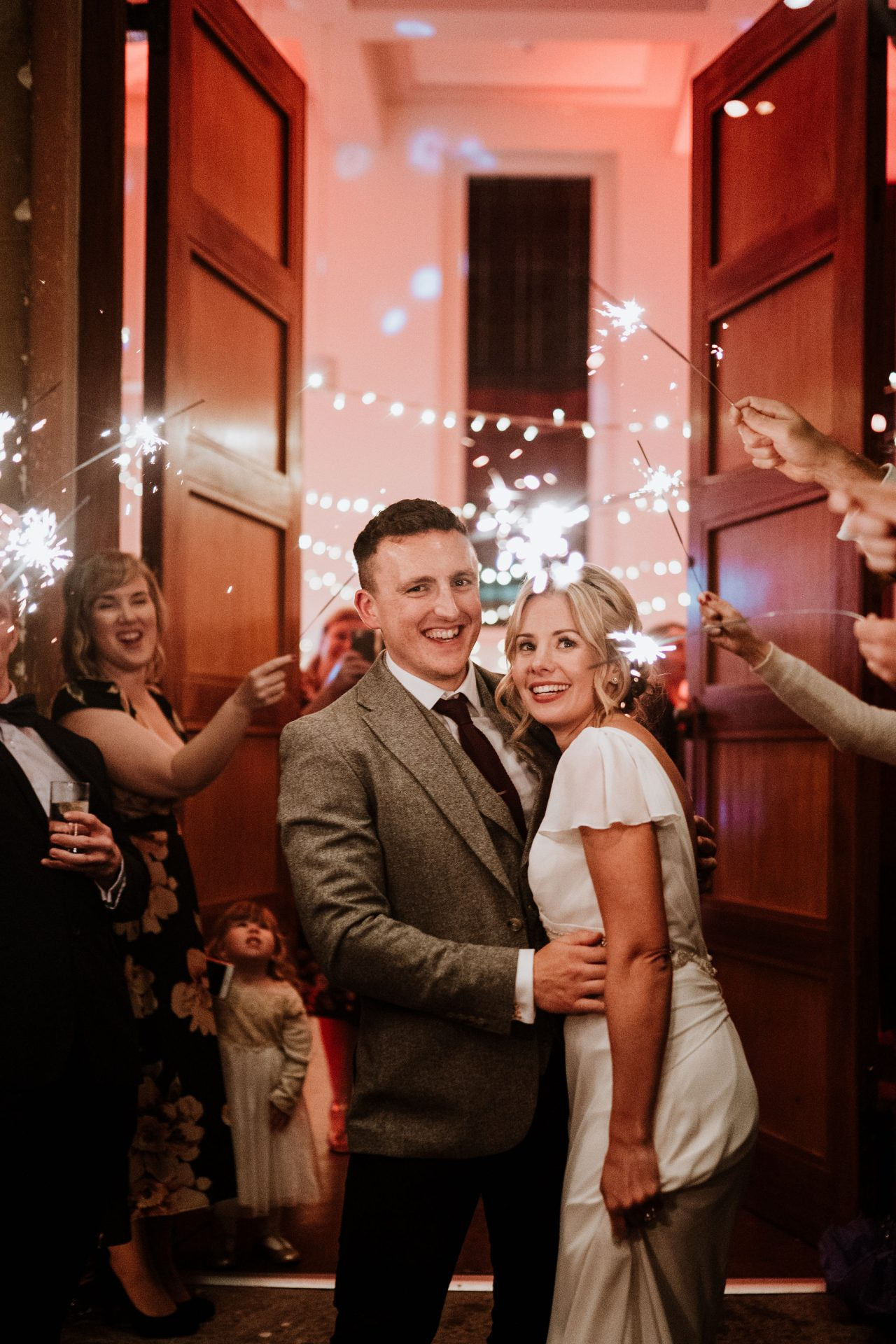 bride and groom laughing sparkler exit outside arnos vale
