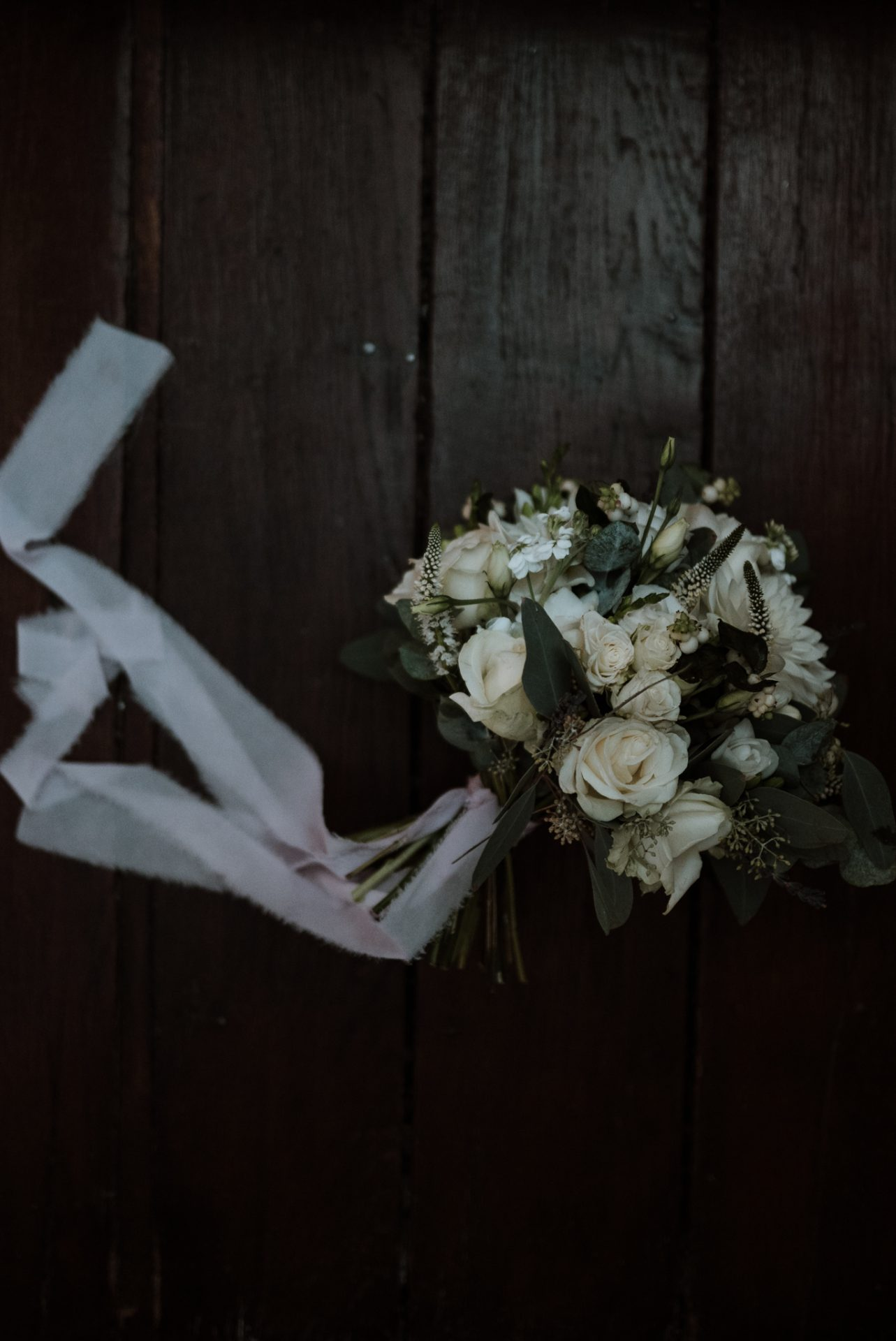 daisy lane floral design bouquet on wooden floor