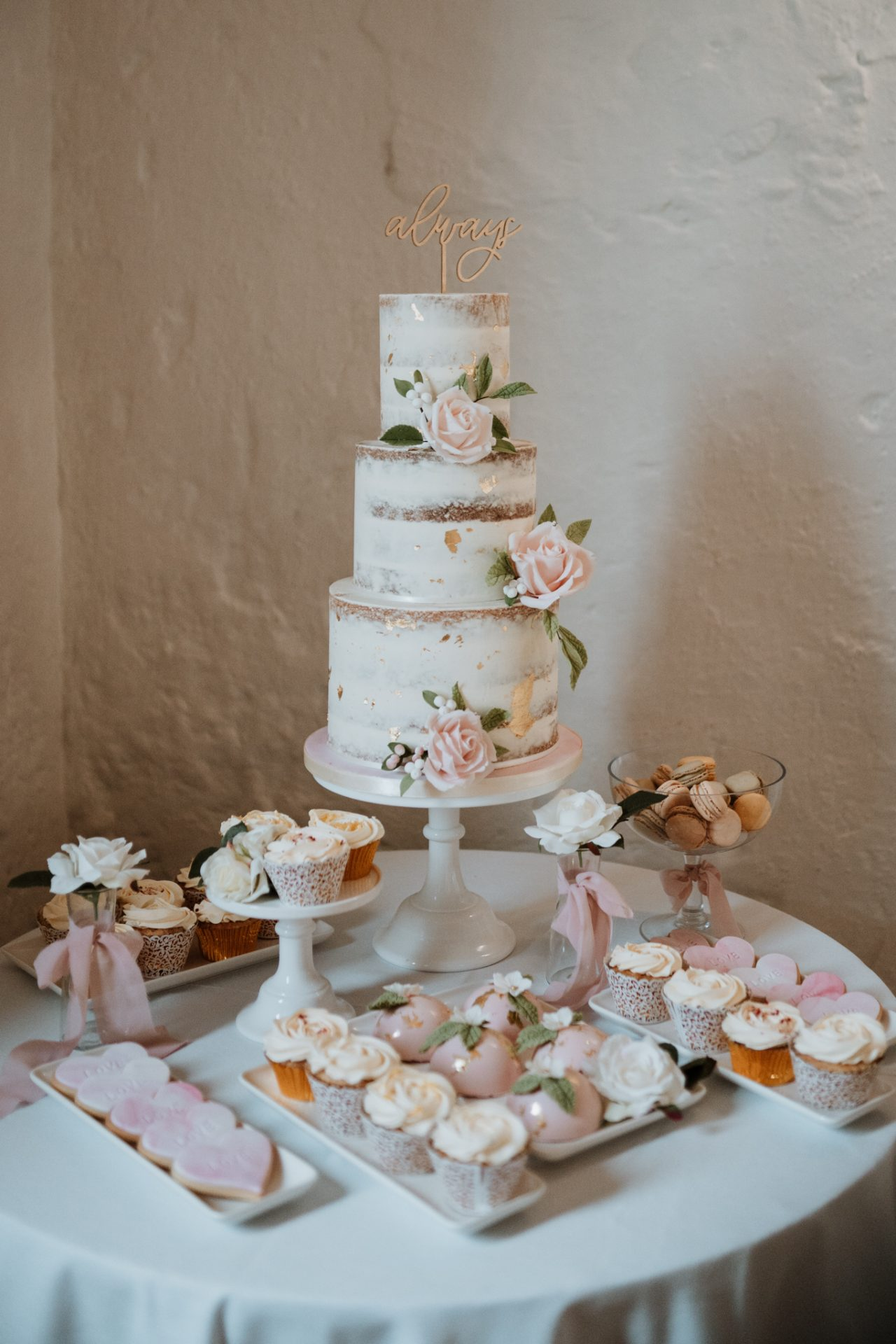 naked cake and vintage cakes dessert table