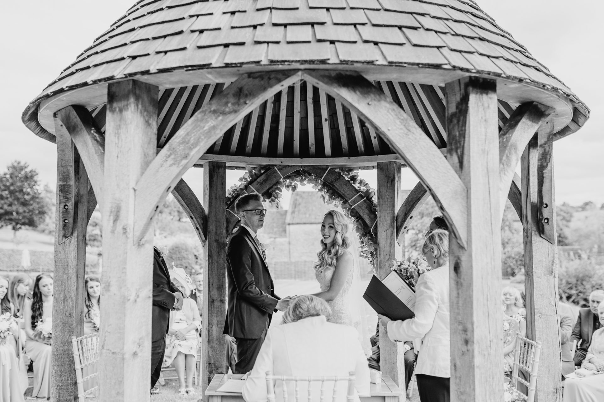 bride and groom get married under gazebo outdoor ceremony
