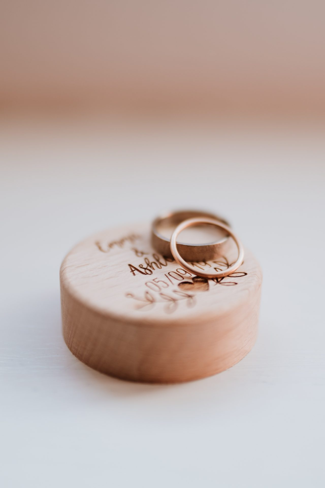rose gold wedding rings on personalised ring box