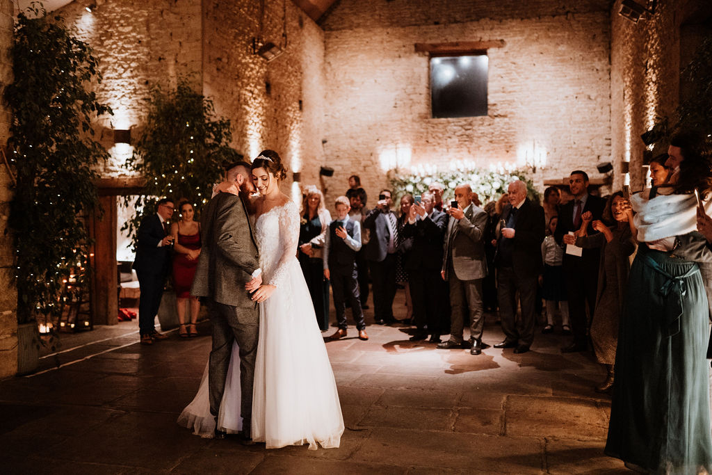 bride and groom's first dance at cripps barn