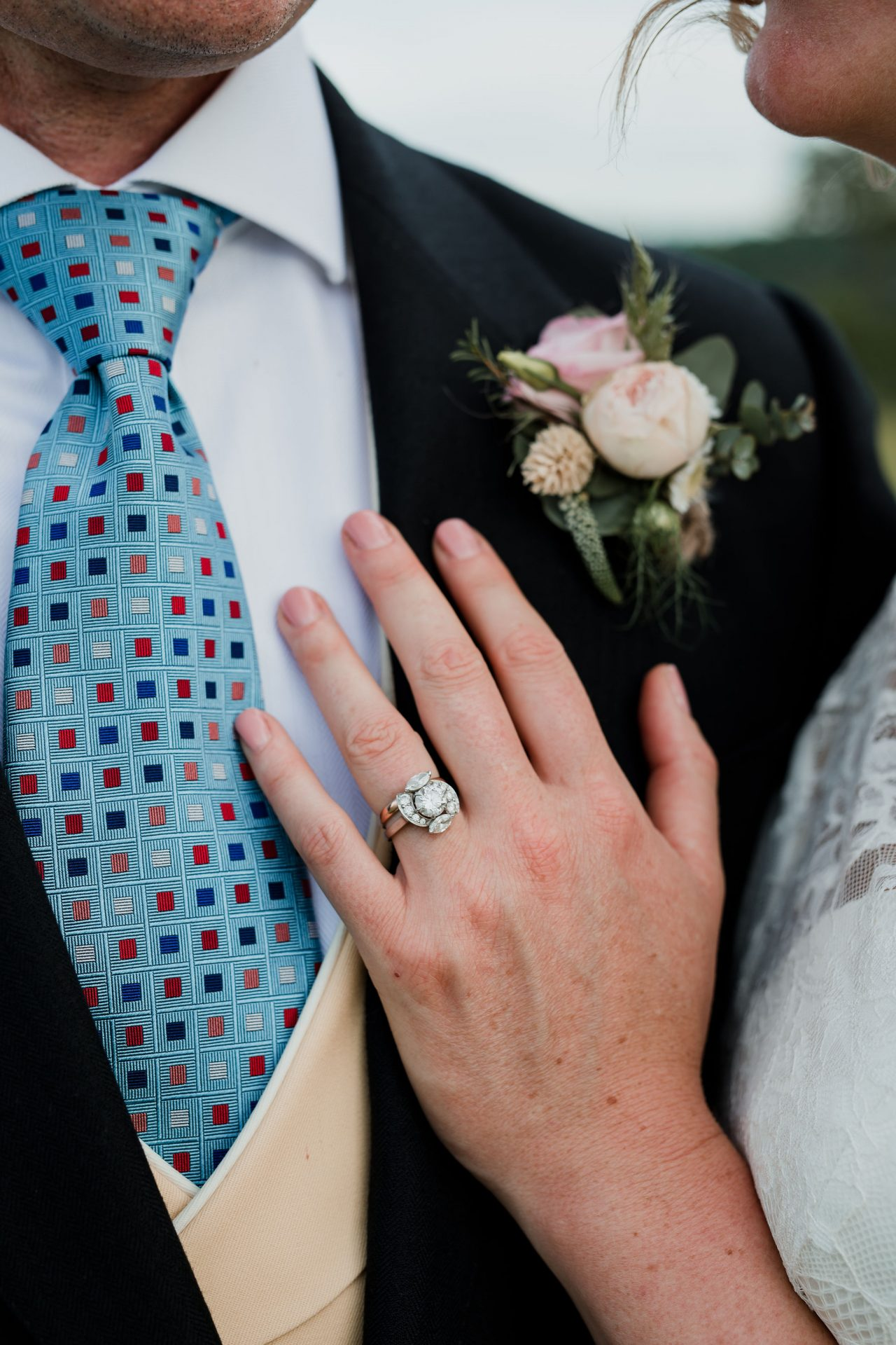 close of of wedding ring and buttonhole