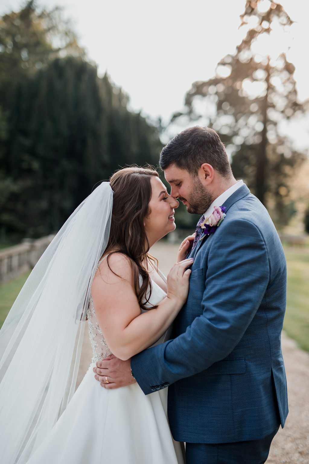 bride and groom touch noses at golden hour orchardleigh house