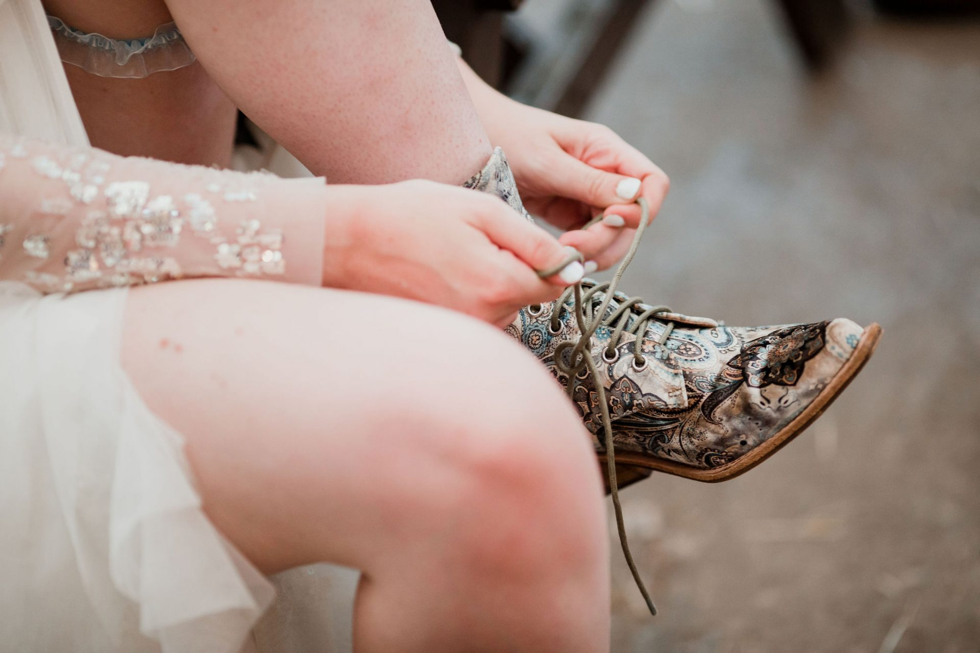 bride tying up her boots