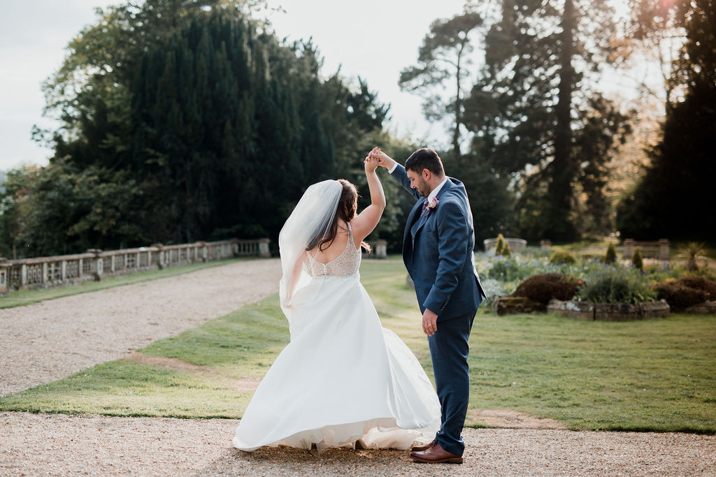 bride and groom dancing at golden hour