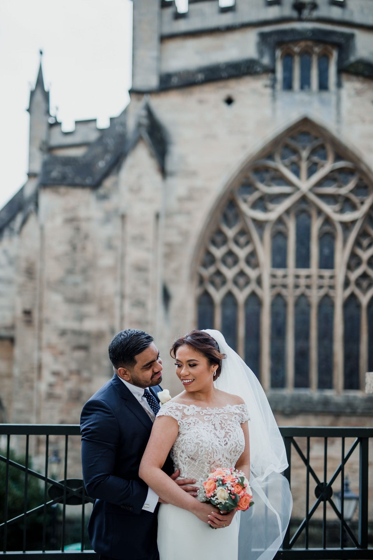 bride and groom in front of bristol cathedral