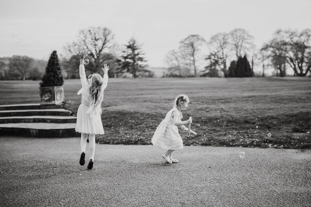 flower girls playing with bubbles