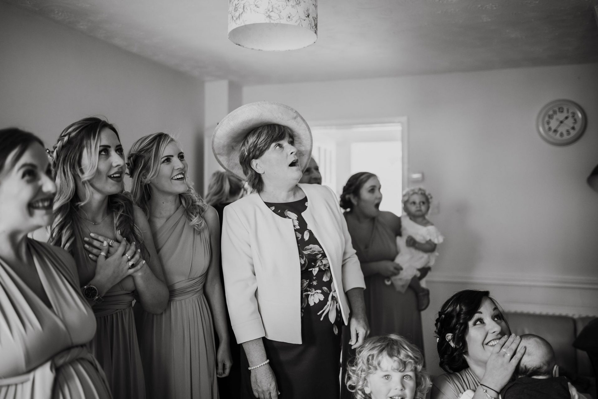 mum and bridesmaids reaction seeing bride in wedding dress