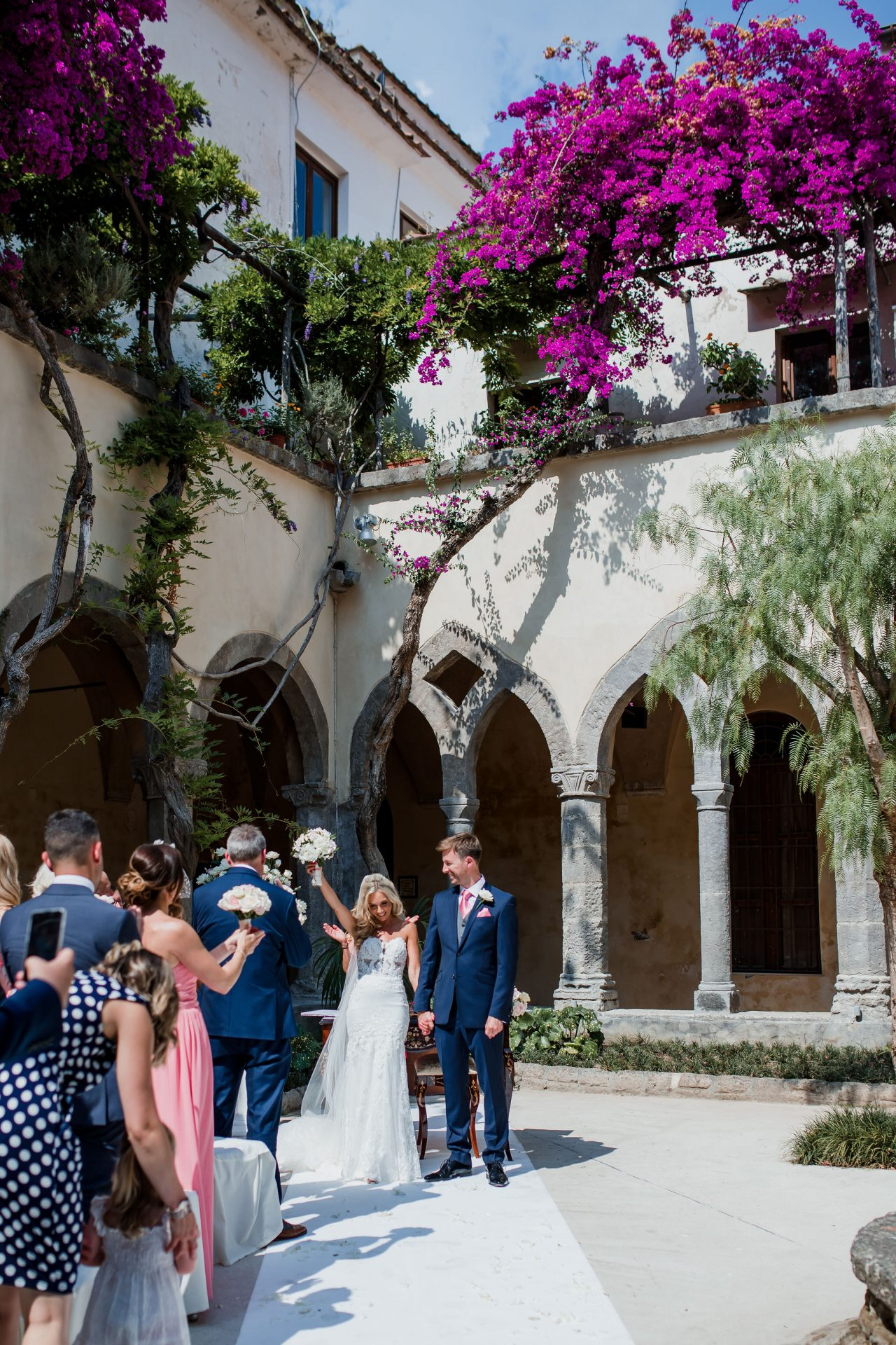 bride celebrates by whopping after ceremony at sorrento cloisters