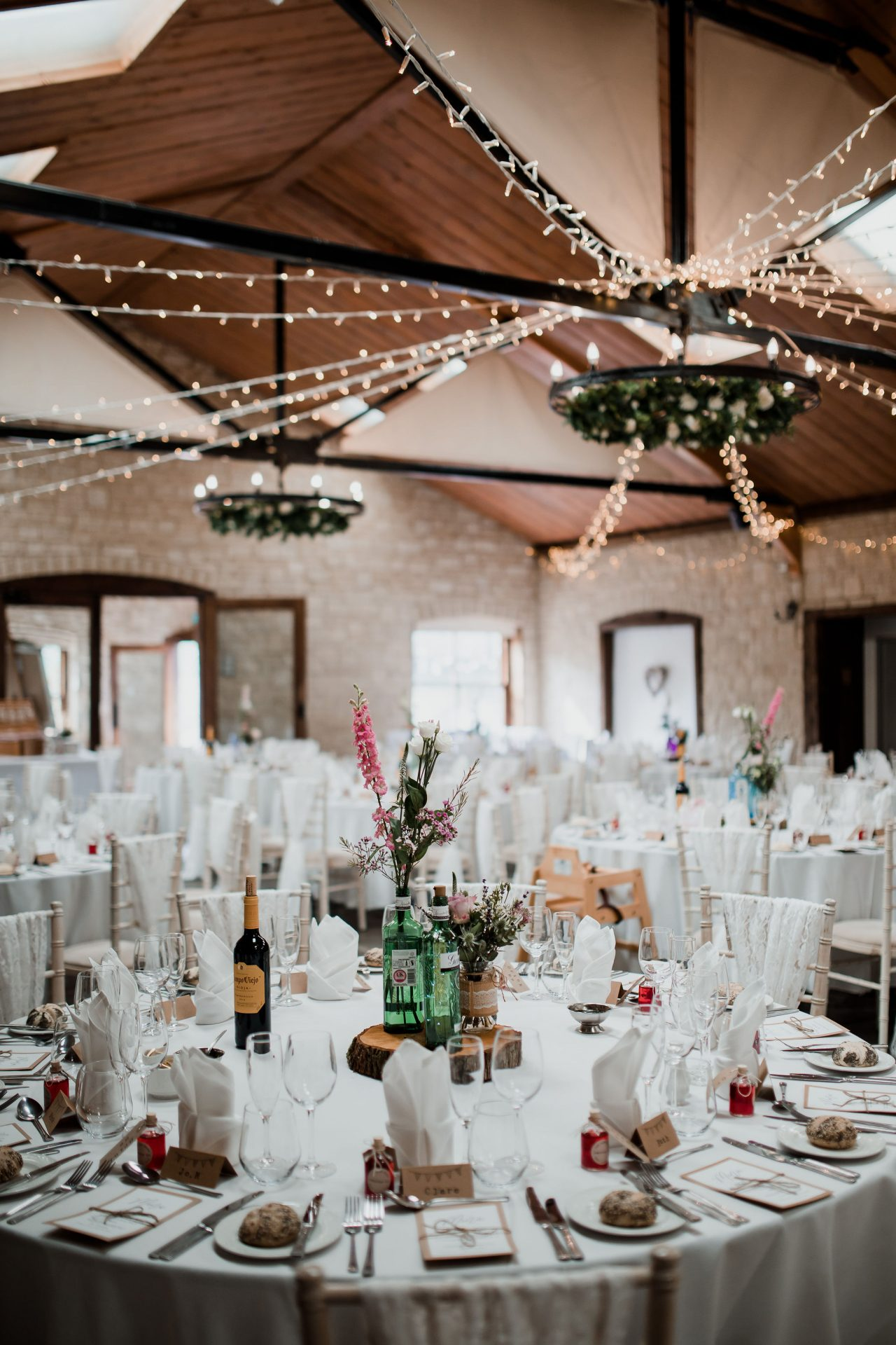 wedding table decor vintage fairy lights at The Barn at Berkeley
