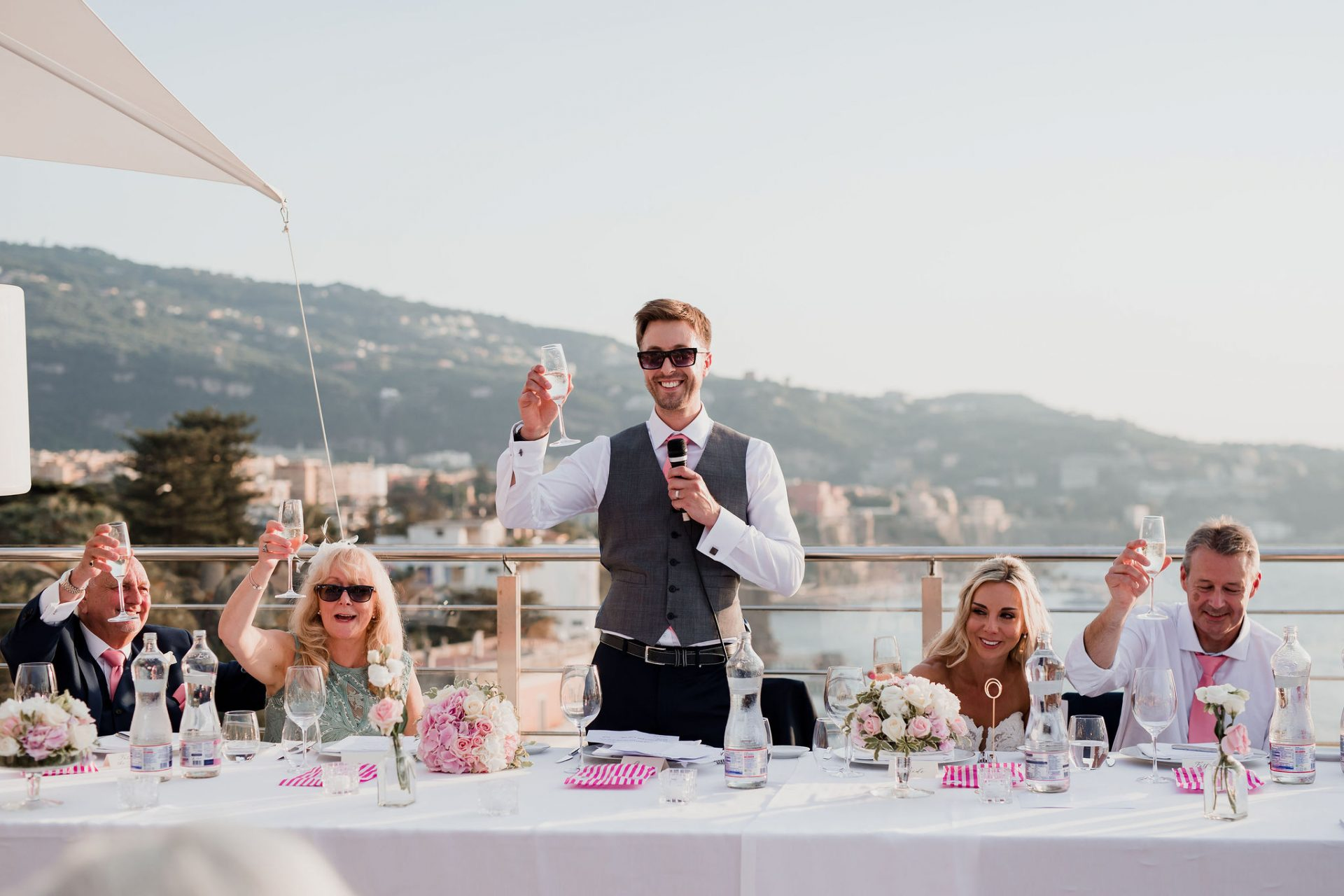 groom toasts during wedding speeches top table sorrento