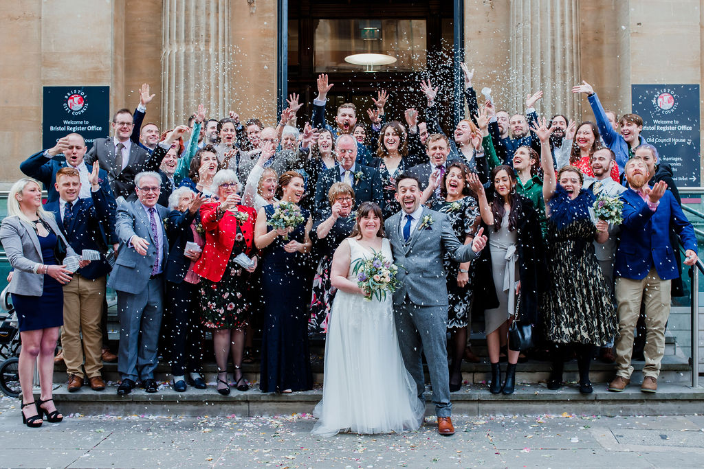wedding guests throw confetti outside bristol registry office