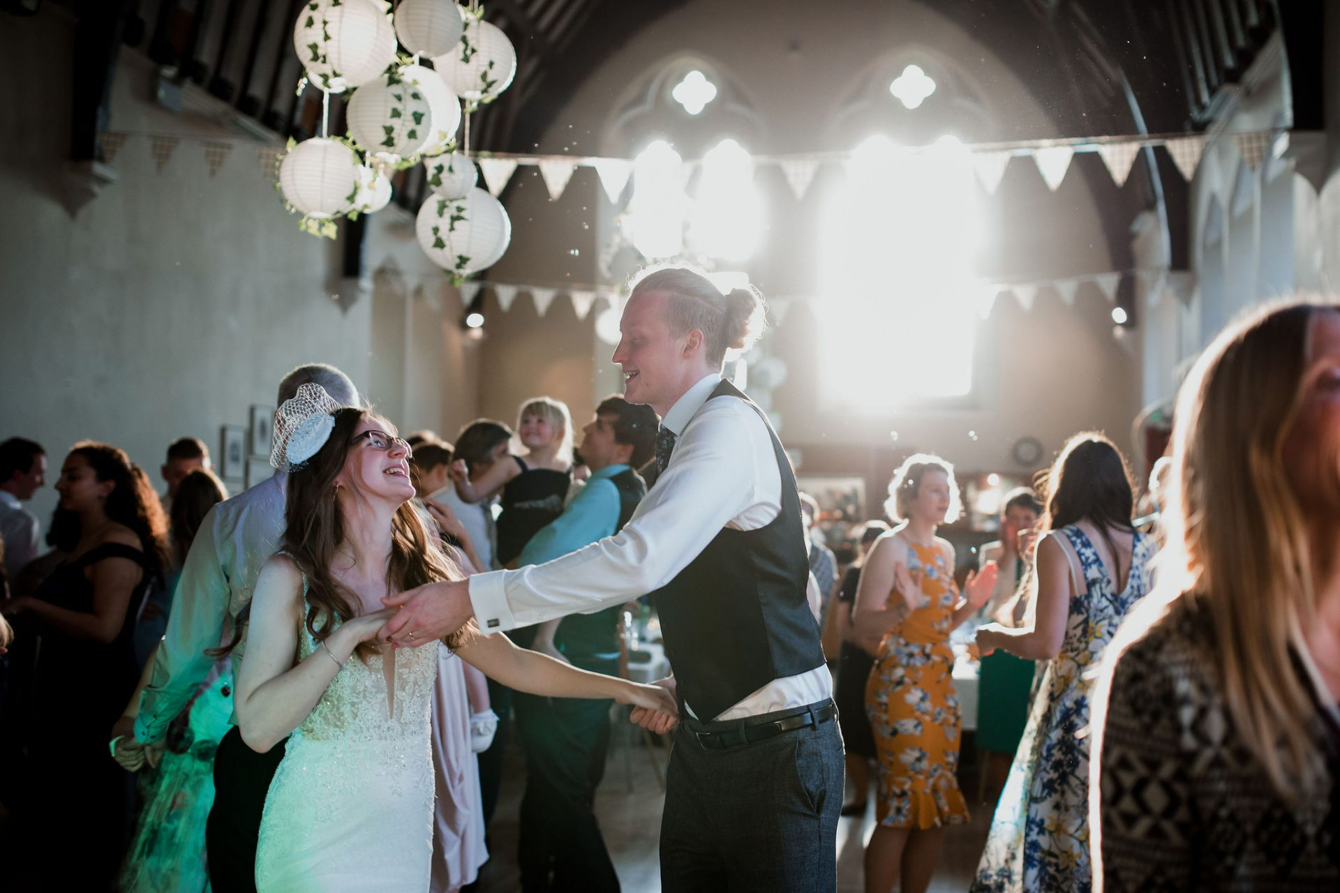 bride and groom dancing with guests westbury on trym village hall