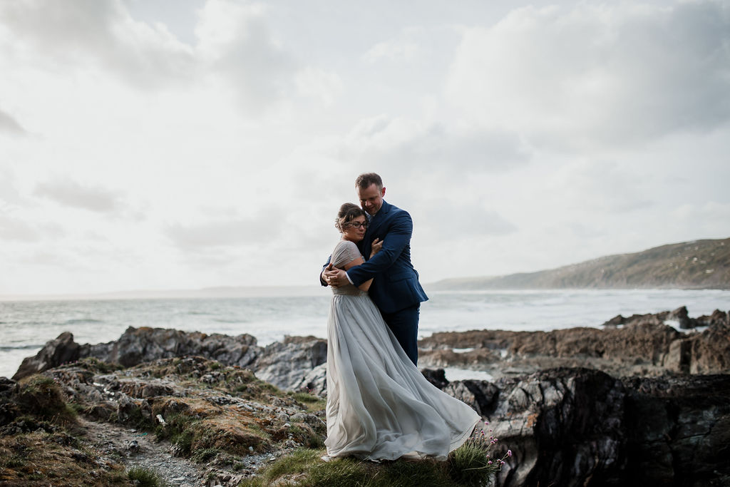 bride and groom hugging by the sea cornwall