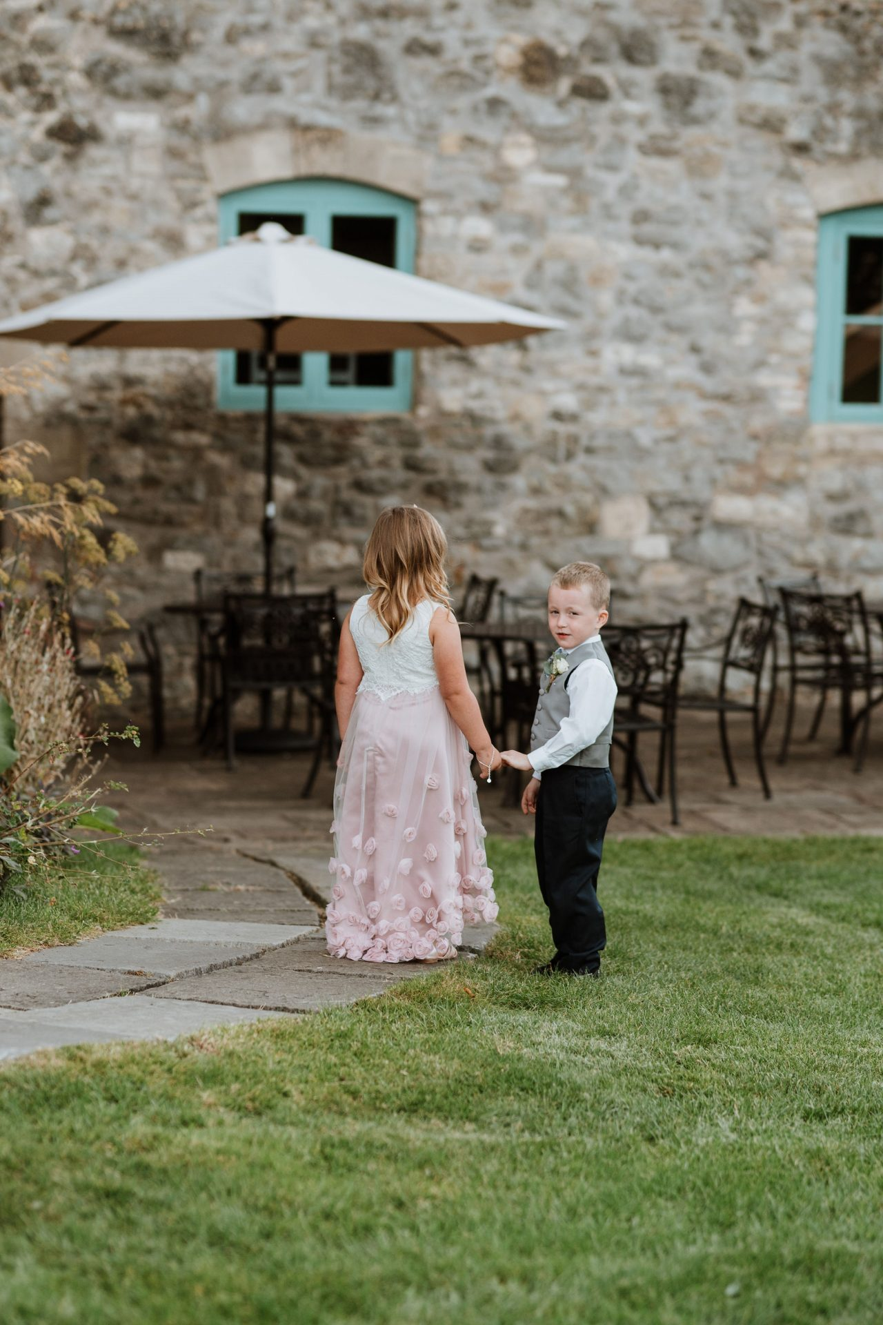 flower girl and page boy holding hands