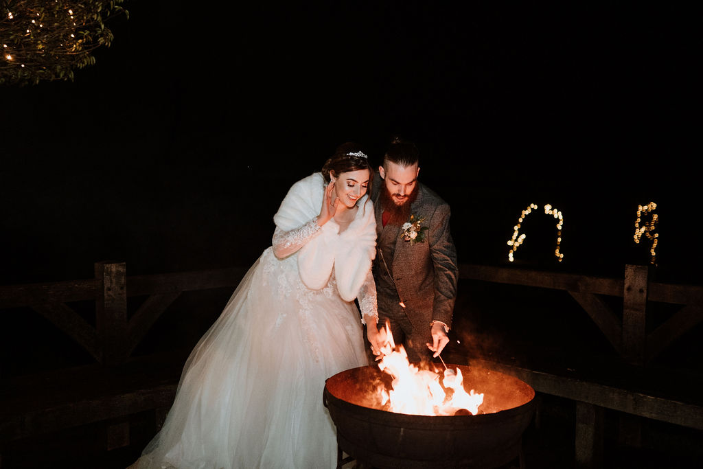 bride and groom toast marshmallows