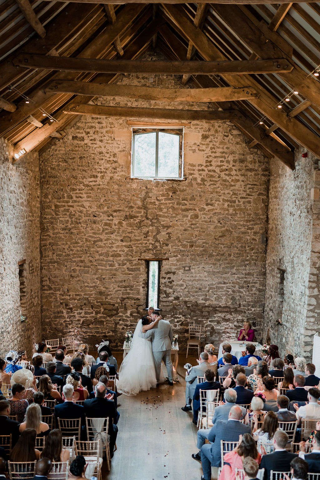 bride and grooms first kiss priston mill