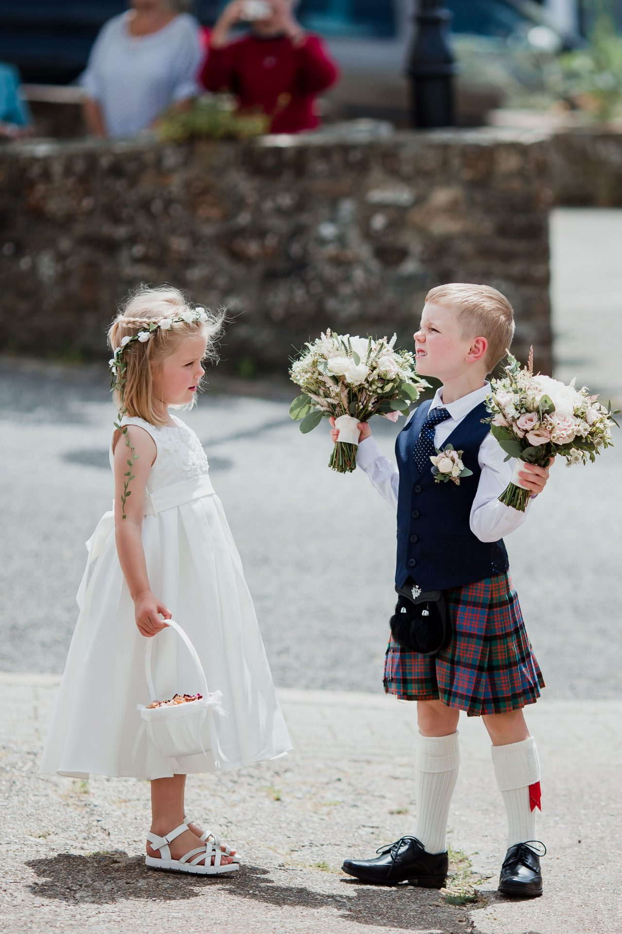 flower girl and page boy holding bouquets