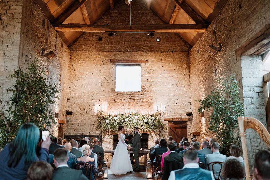 bride and groom wedding ceremony in cripps barn