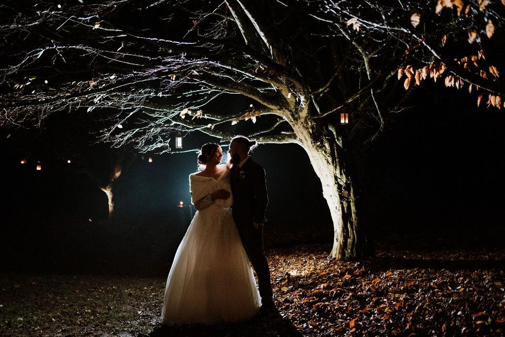 winter wedding backlit bride and groom