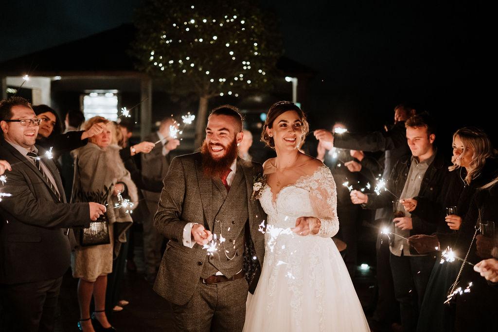 sparkler tunnel bride and groom