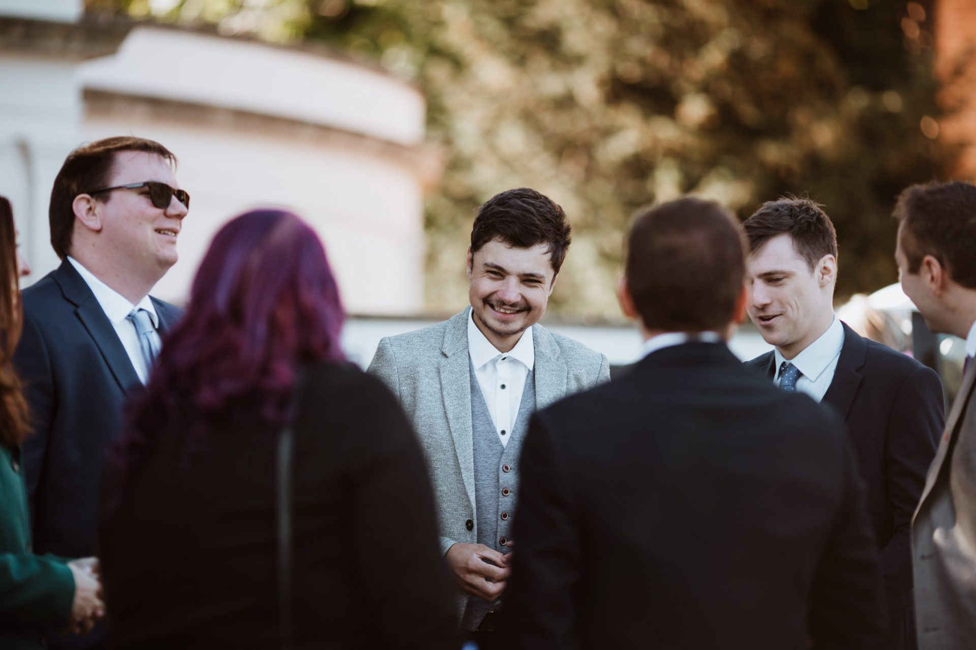 candid photo of guests laughing before the ceremony