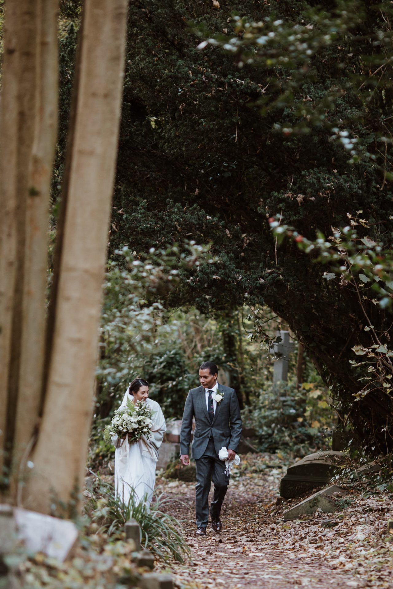 bride and father walking through arnos vale woods