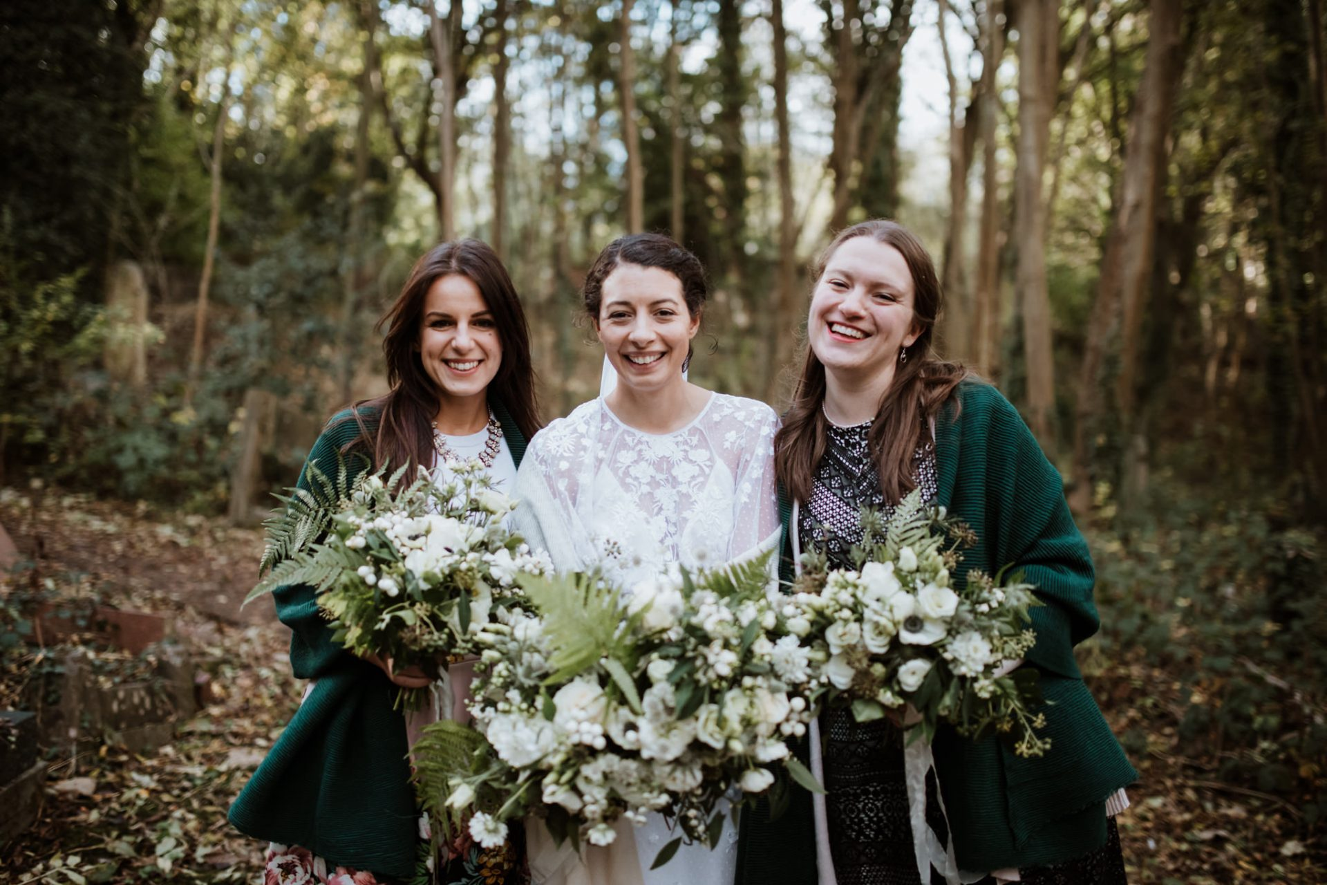 bride and bridesmaids group photos in the woods