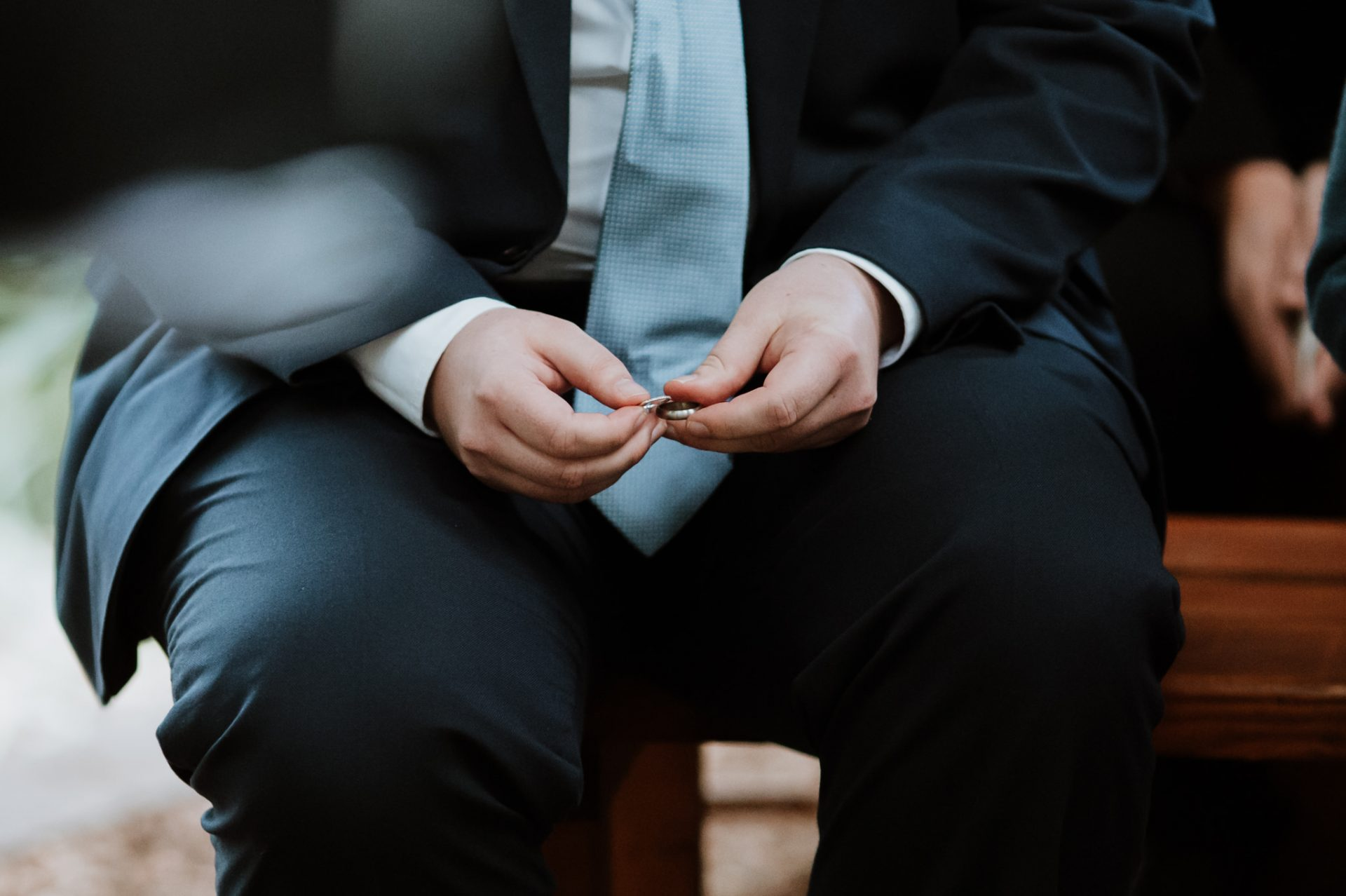 best man holding the wedding rings