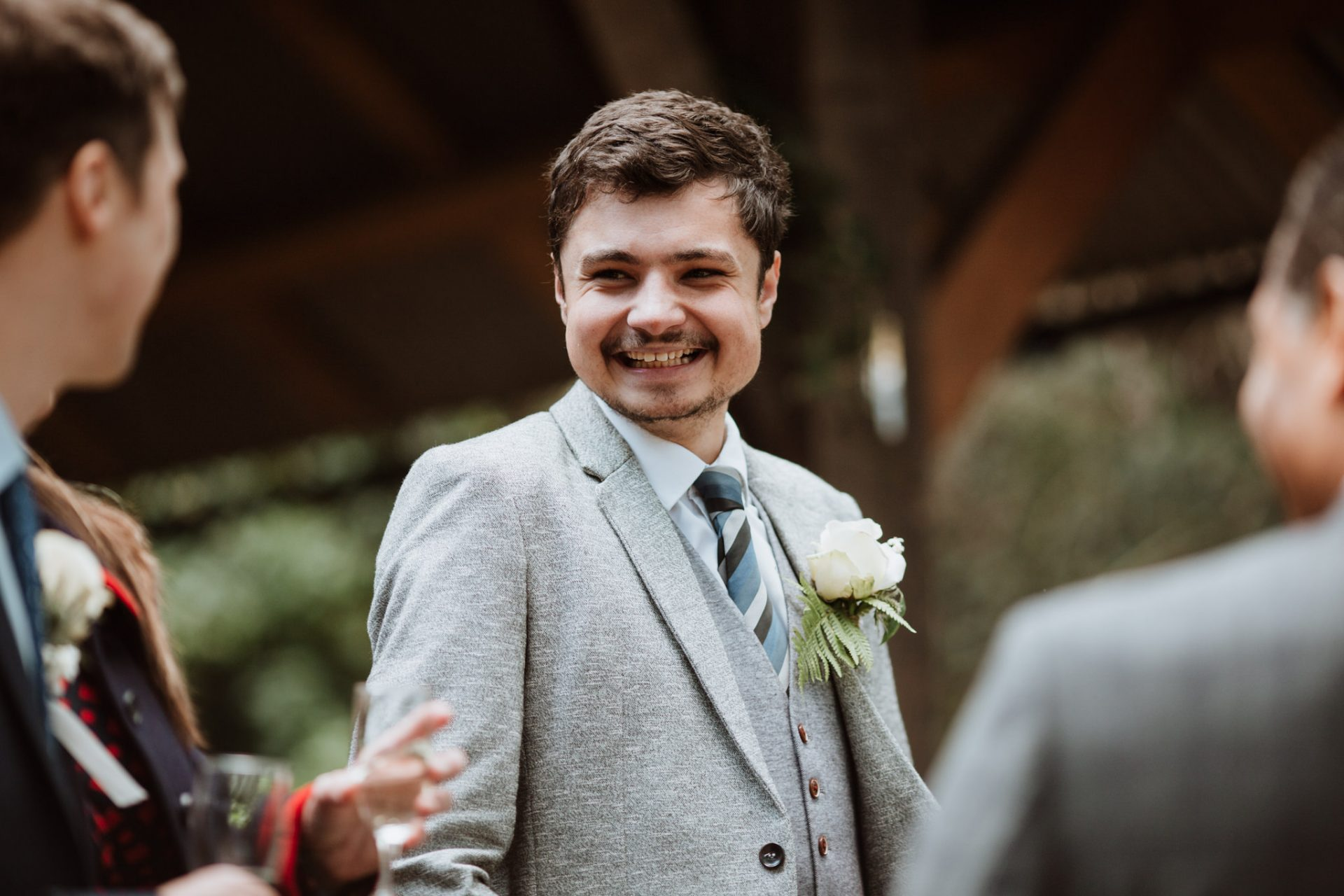 candid photograph wedding guest laughing