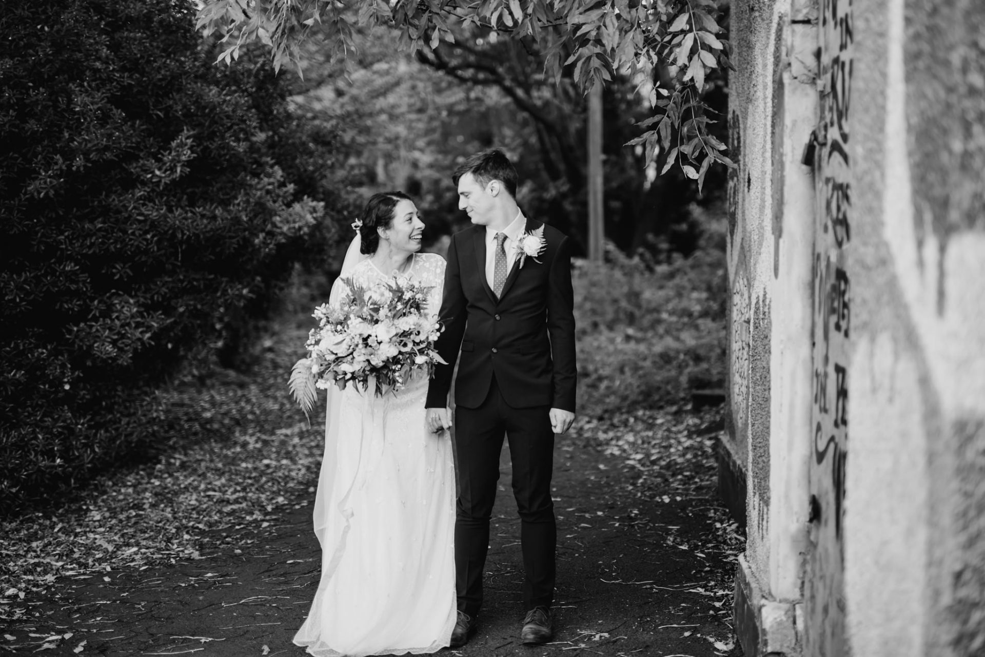 bride and groom standing outside graffiti bristol arnos vale wedding