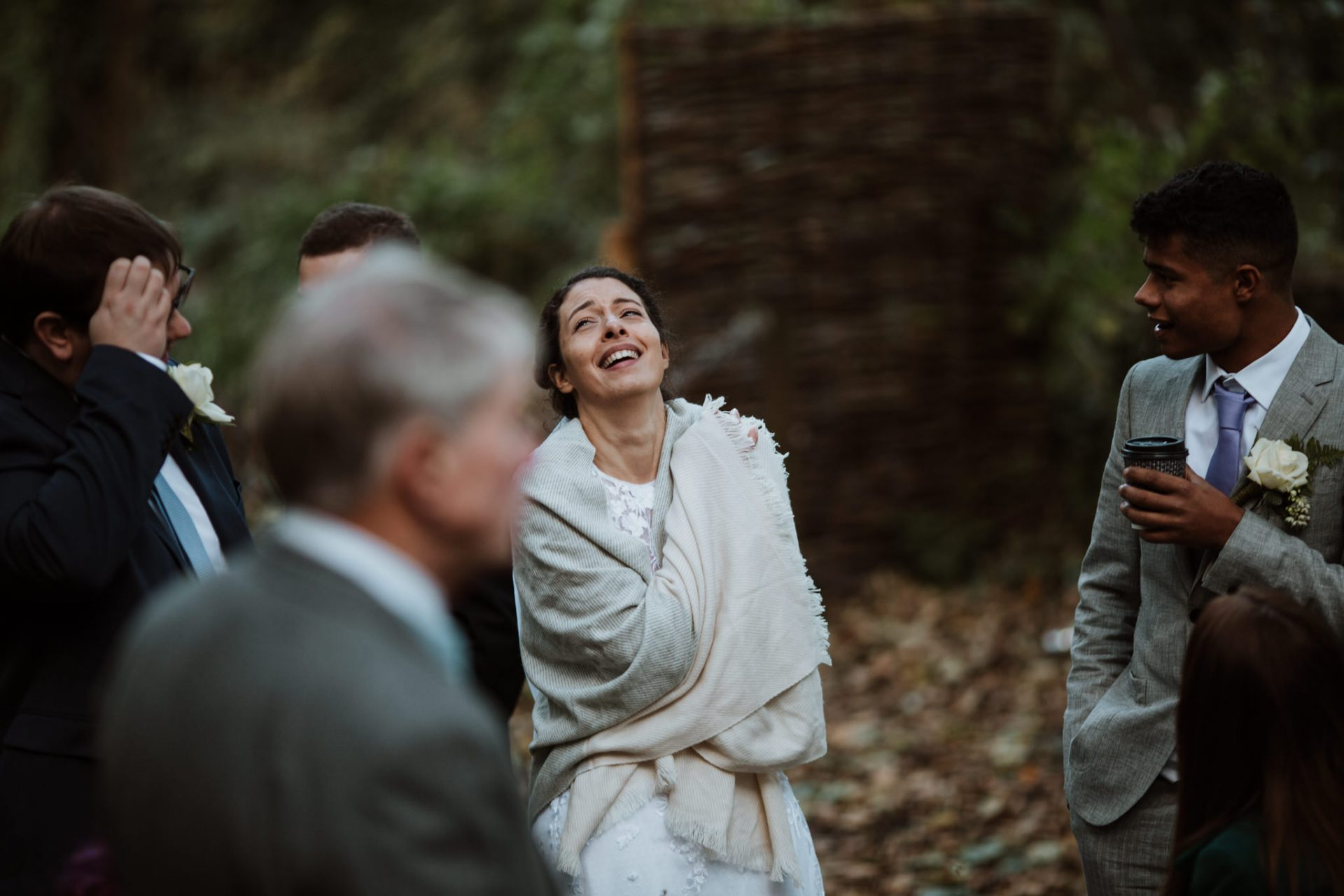 wedding guests laughing candid wedding photography
