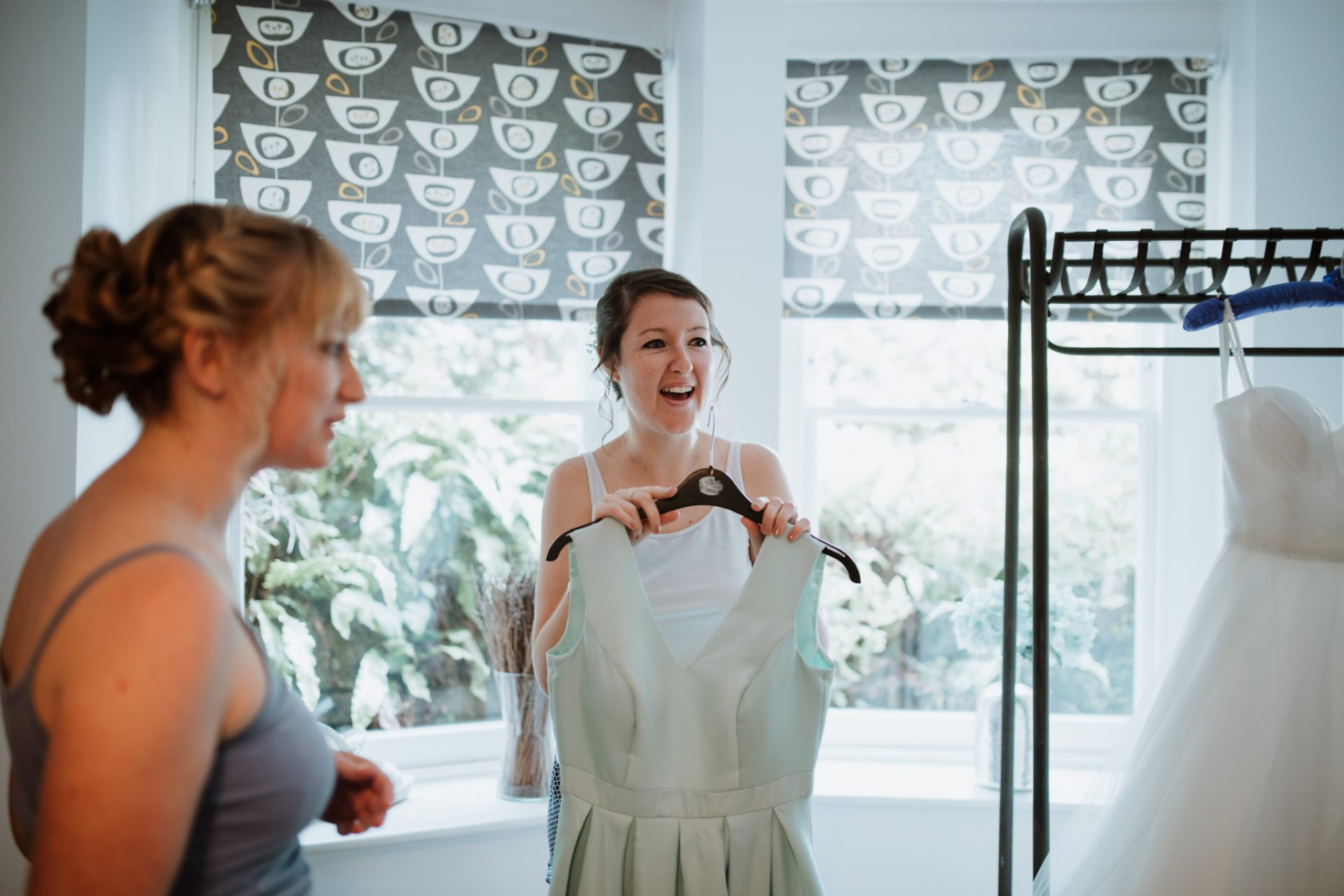 bridesmaid excited about putting on her dress
