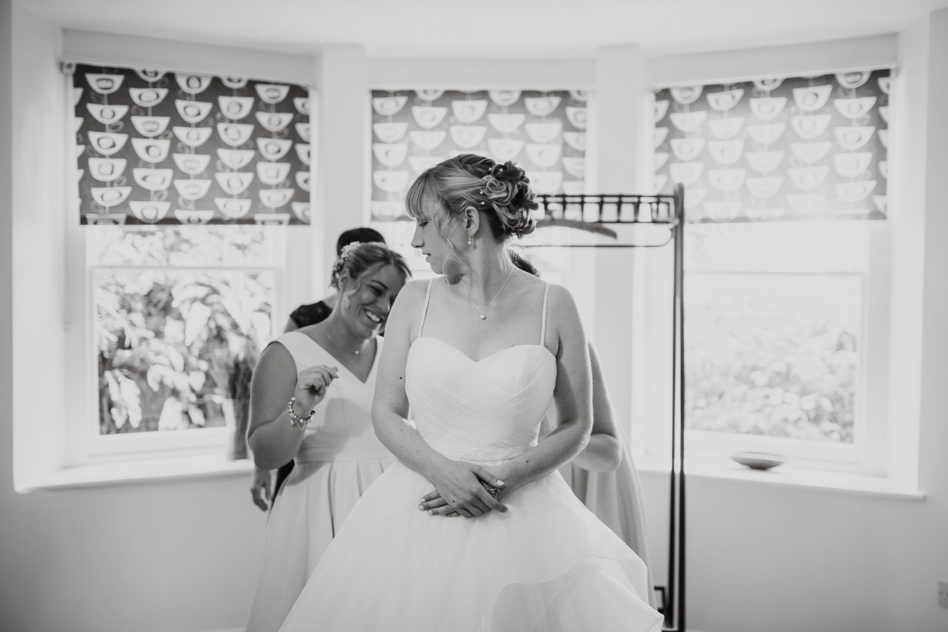 bride getting in to her wedding dress