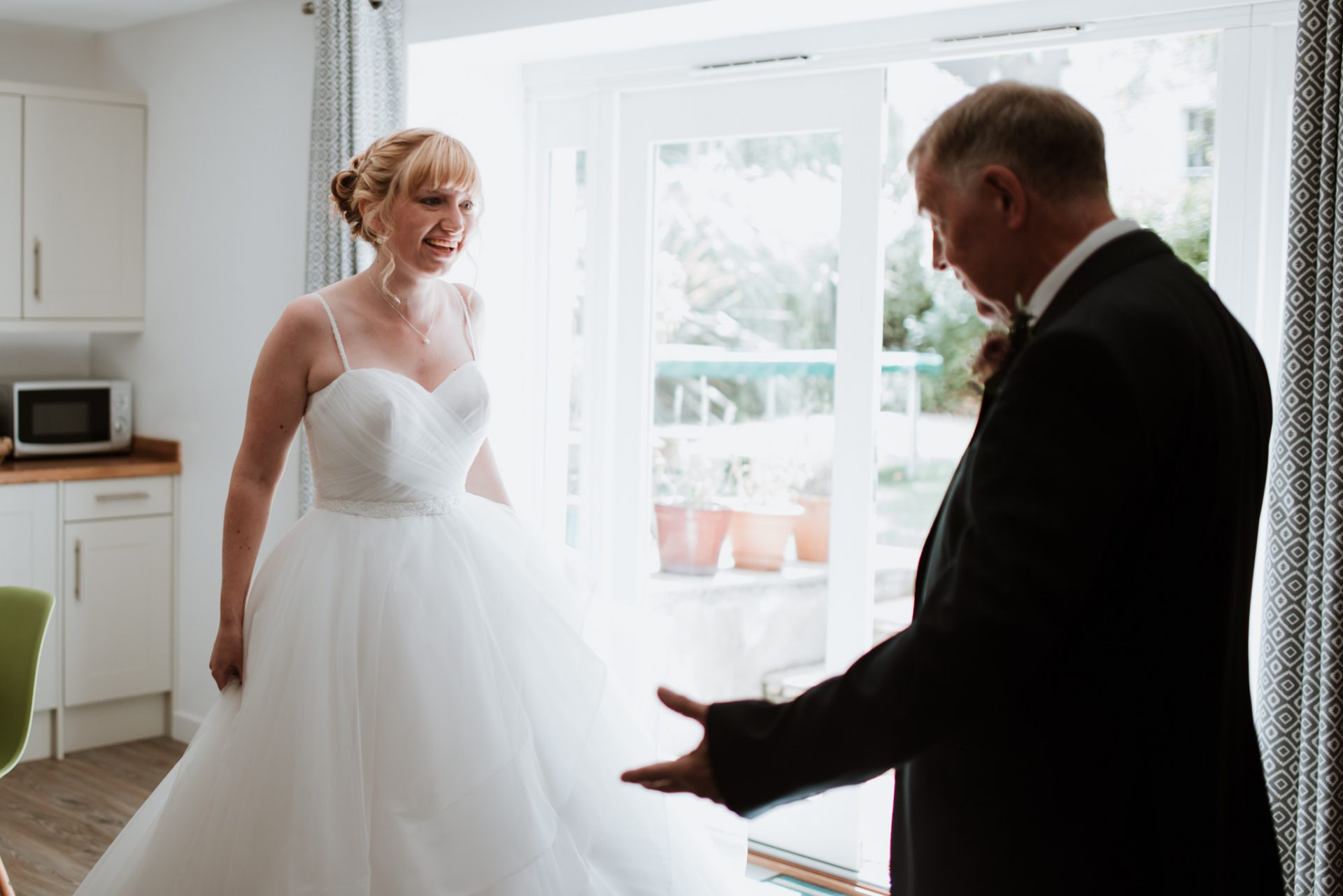 father of the bride amazed by bride in her dress