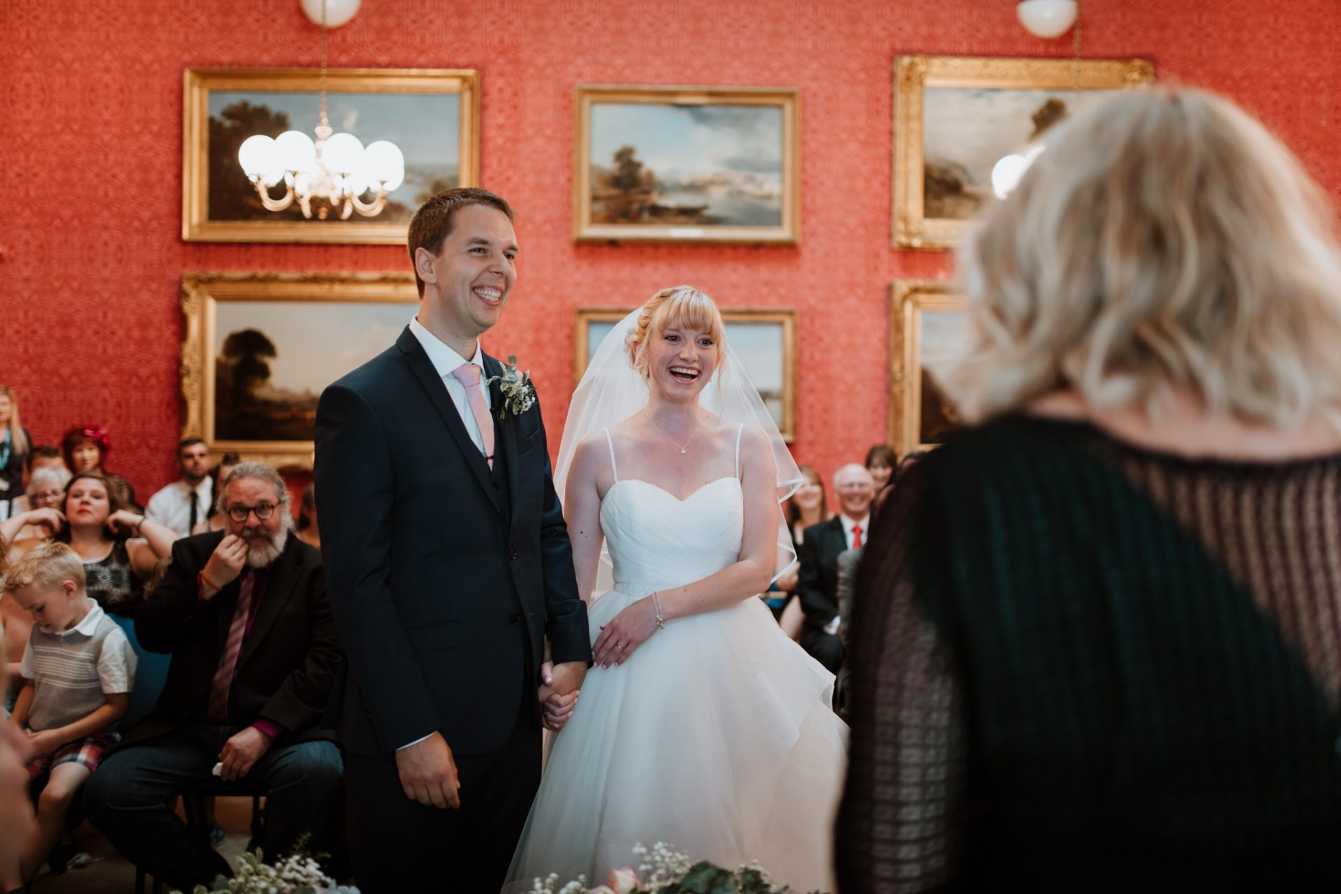 bride and groom smiling during ceremony blaise castle house museum
