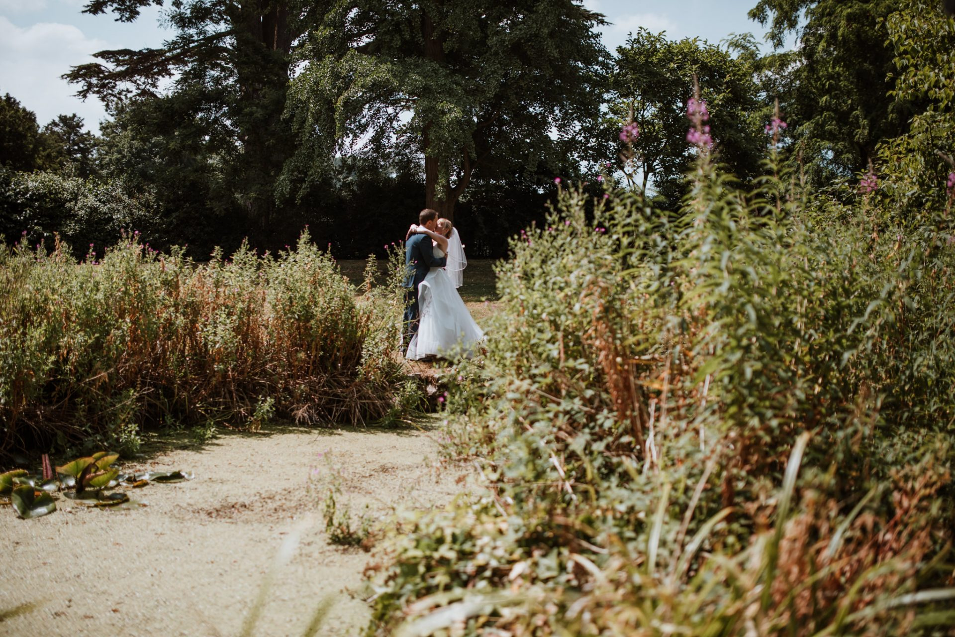 bride and groom hugging wedding portraits dairy garden blaise castle