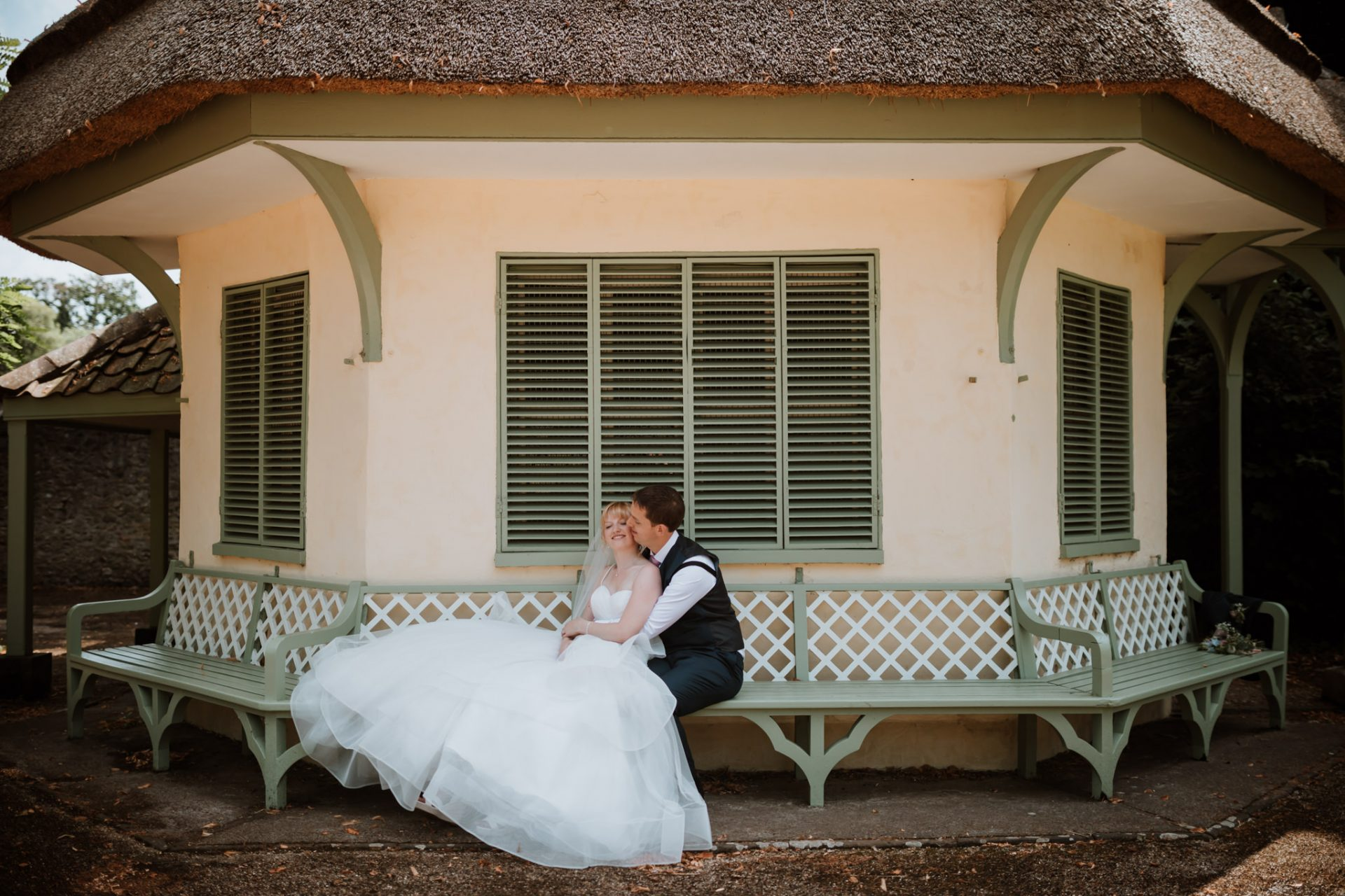 bride and groom sat in front of the dairy house blaise castle