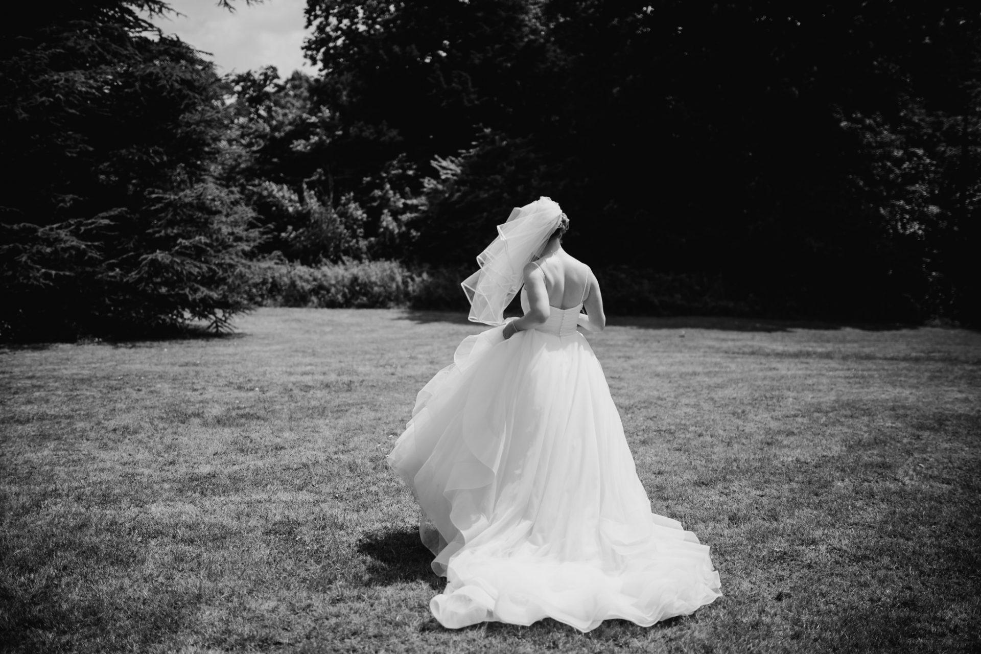 bride walking away across the lane