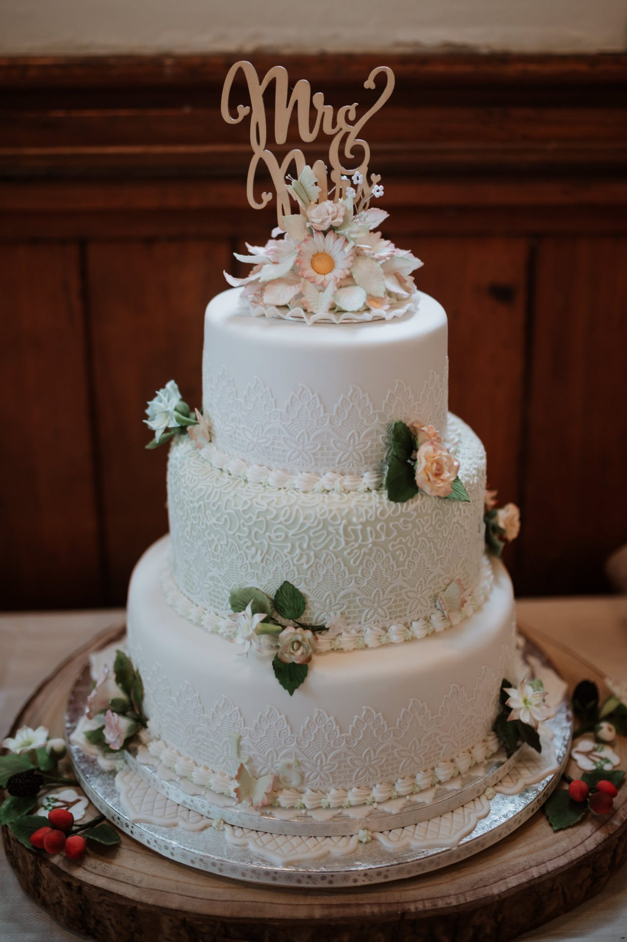 piped white wedding cake roses