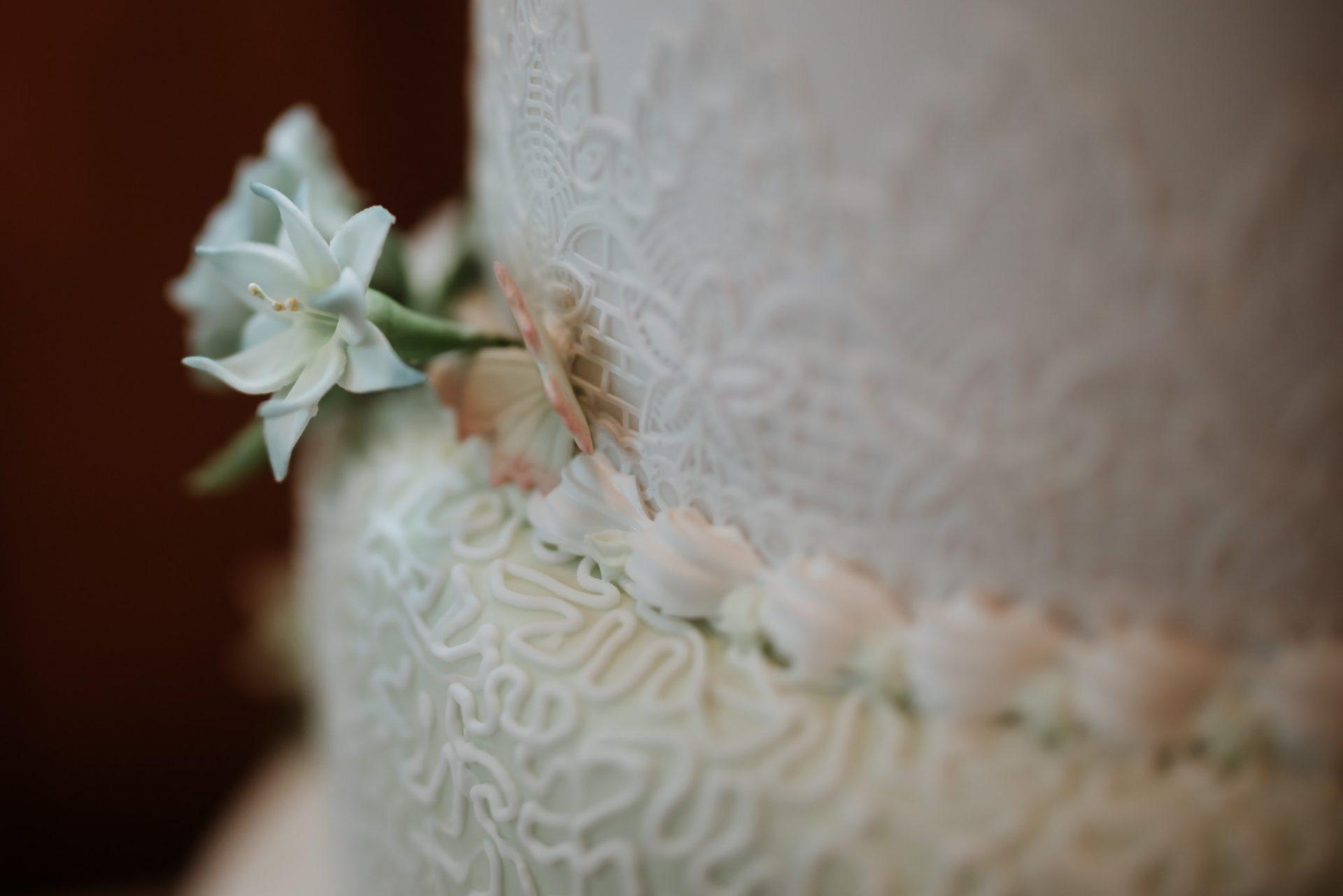 detail of white icing wedding cake