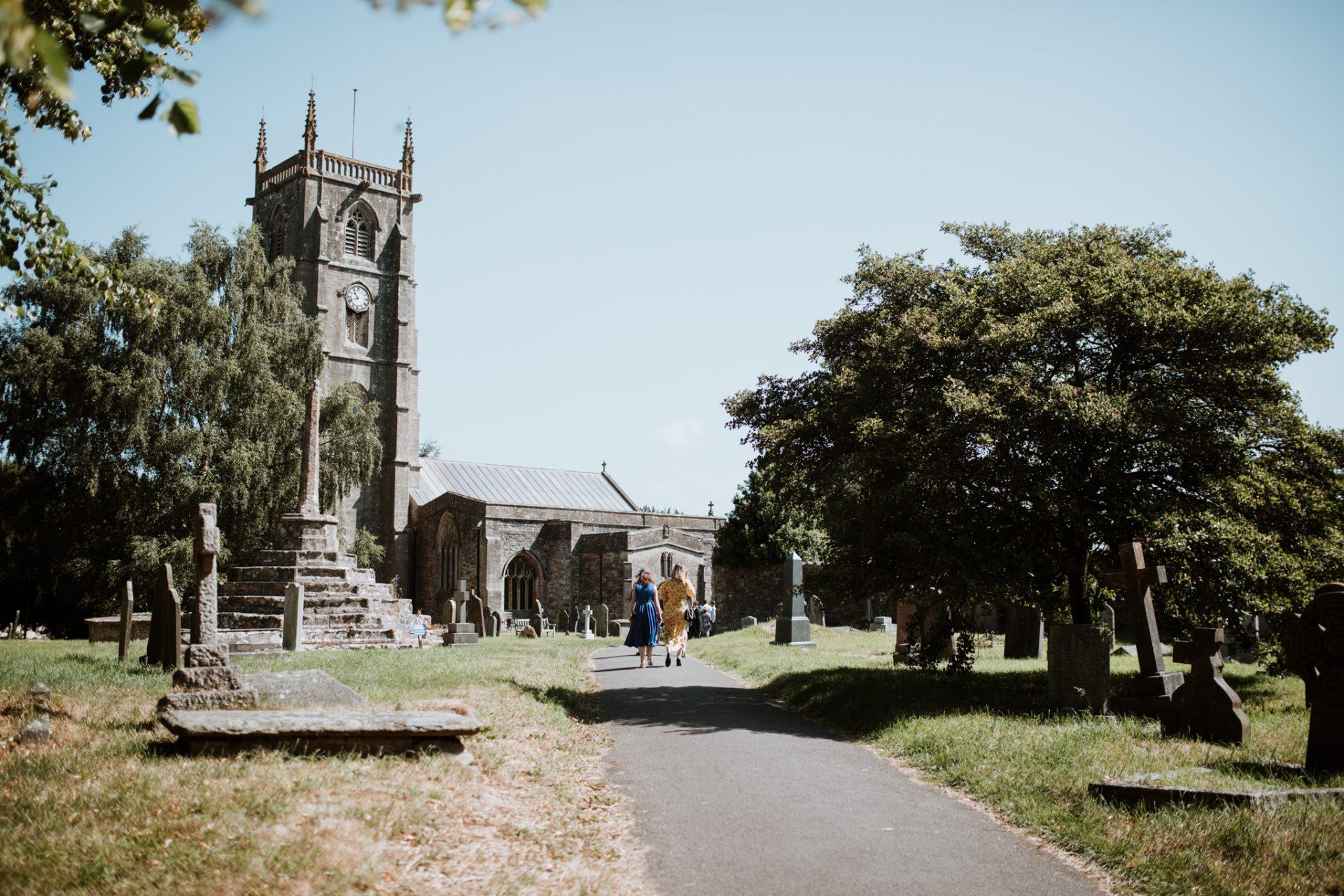 guests walking towards church