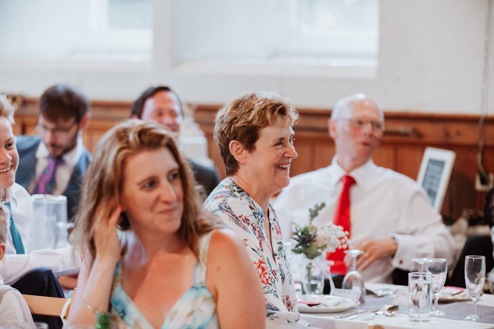 wedding guest laughing speeches candid photography