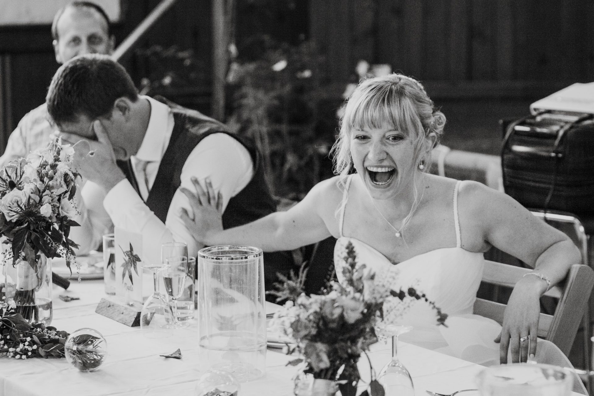 bride laughing hysterically during speeches
