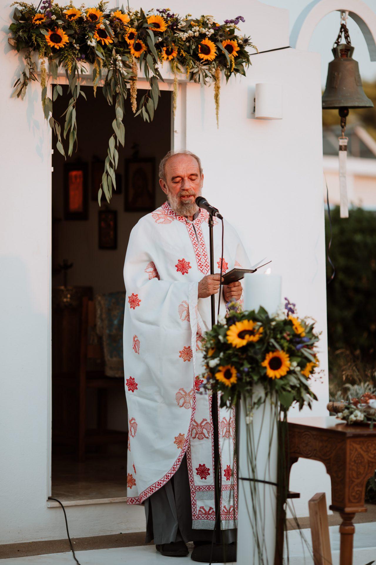 greek orthodox priest conducting ceremony