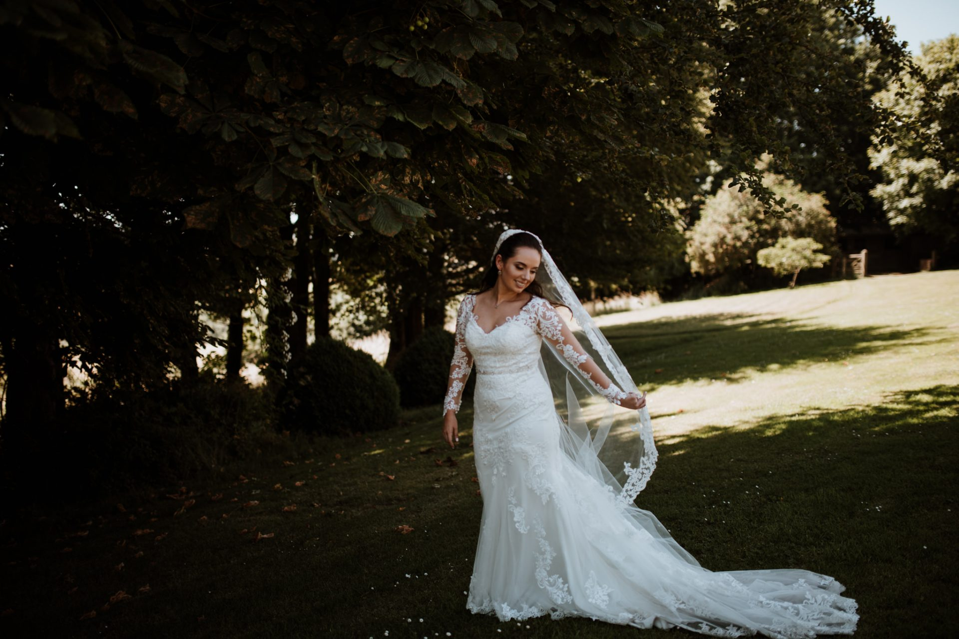 bridal portrait bride swings her veil around