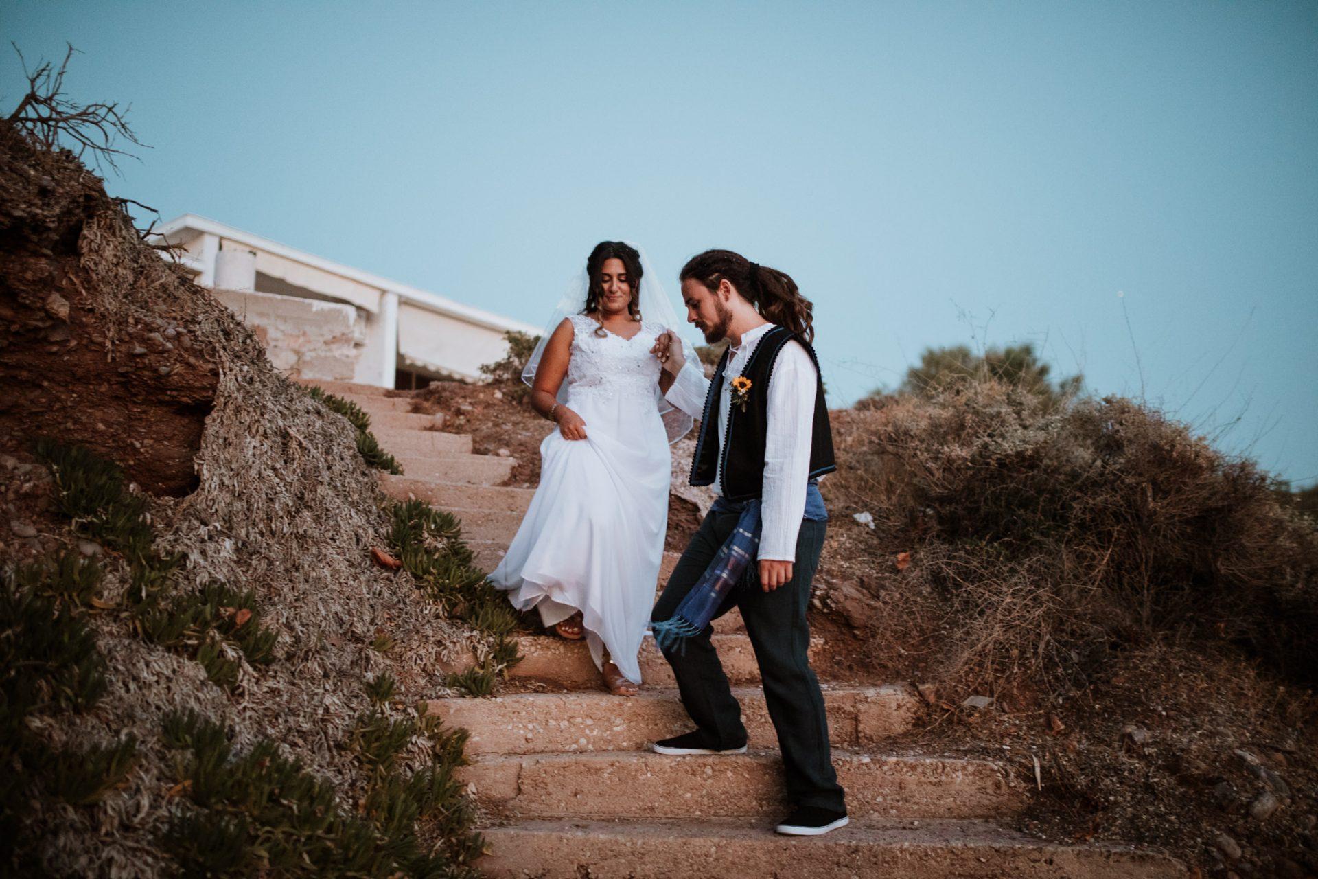 bride and groom walking down stairs